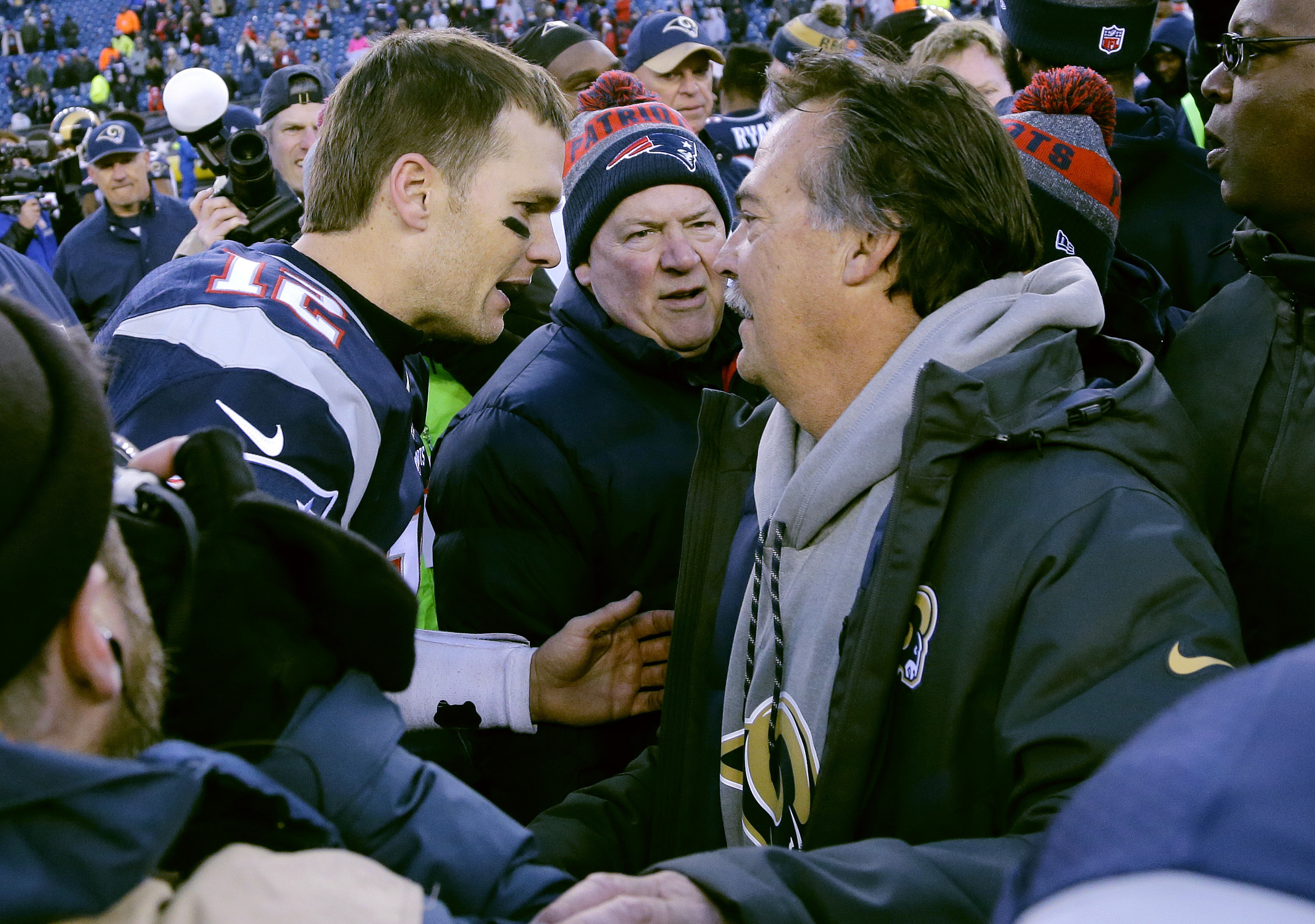New England Patriots quarterback Tom Brady, left, and Los Angeles Rams head coach Jeff Fisher speak at midfield after after an NFL football game, Sunday, Dec. 4, 2016, in Foxborough, Mass. The Patriots won 26-10. (AP Photo/Elise Amendola)