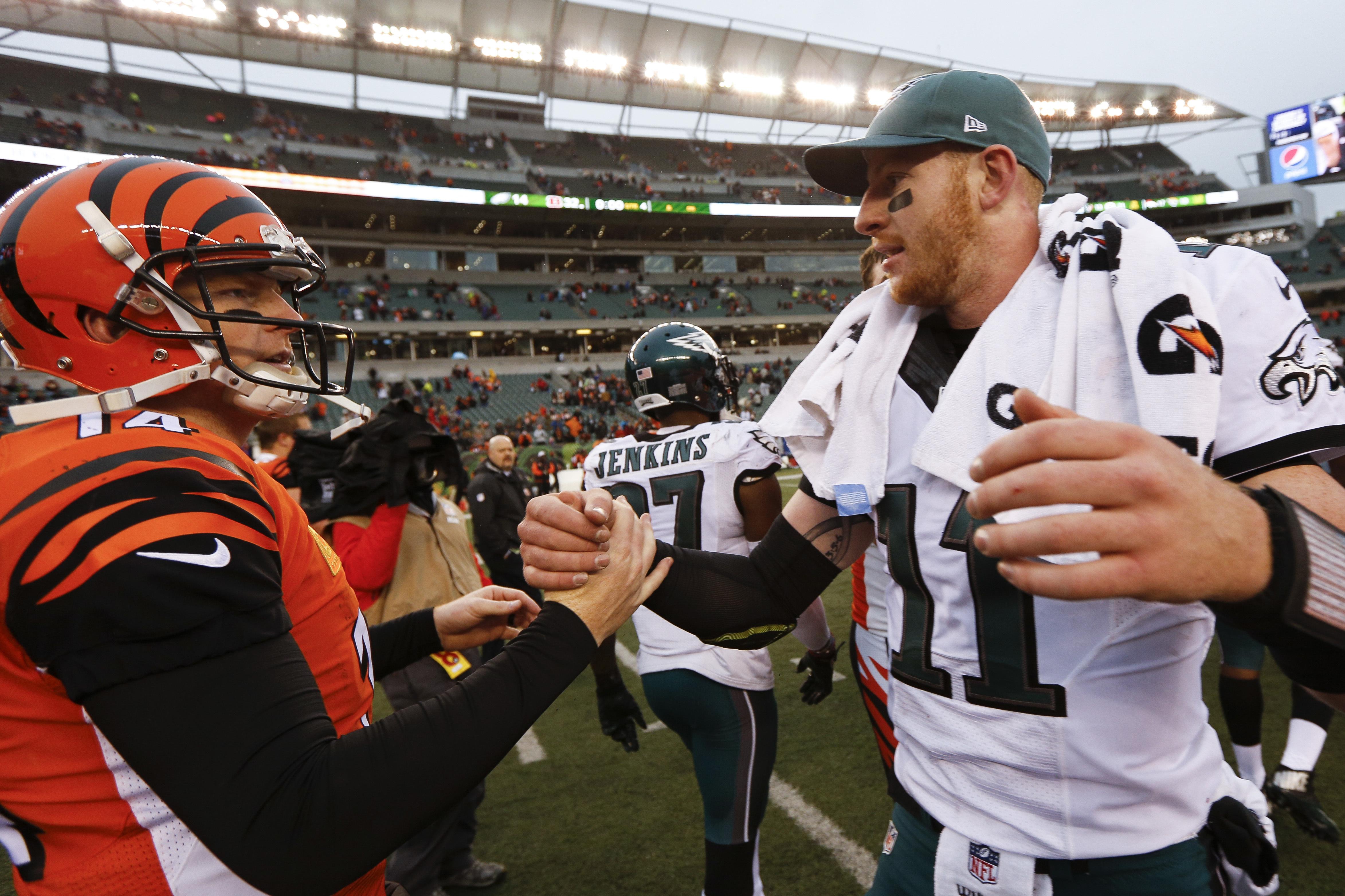 Cincinnati Bengals quarterback Andy Dalton (14) and Philadelphia Eagles quarterback Carson Wentz (11) meet on the field after an NFL football game, Sunday, Dec. 4, 2016, in Cincinnati. (AP Photo/Frank Victores)