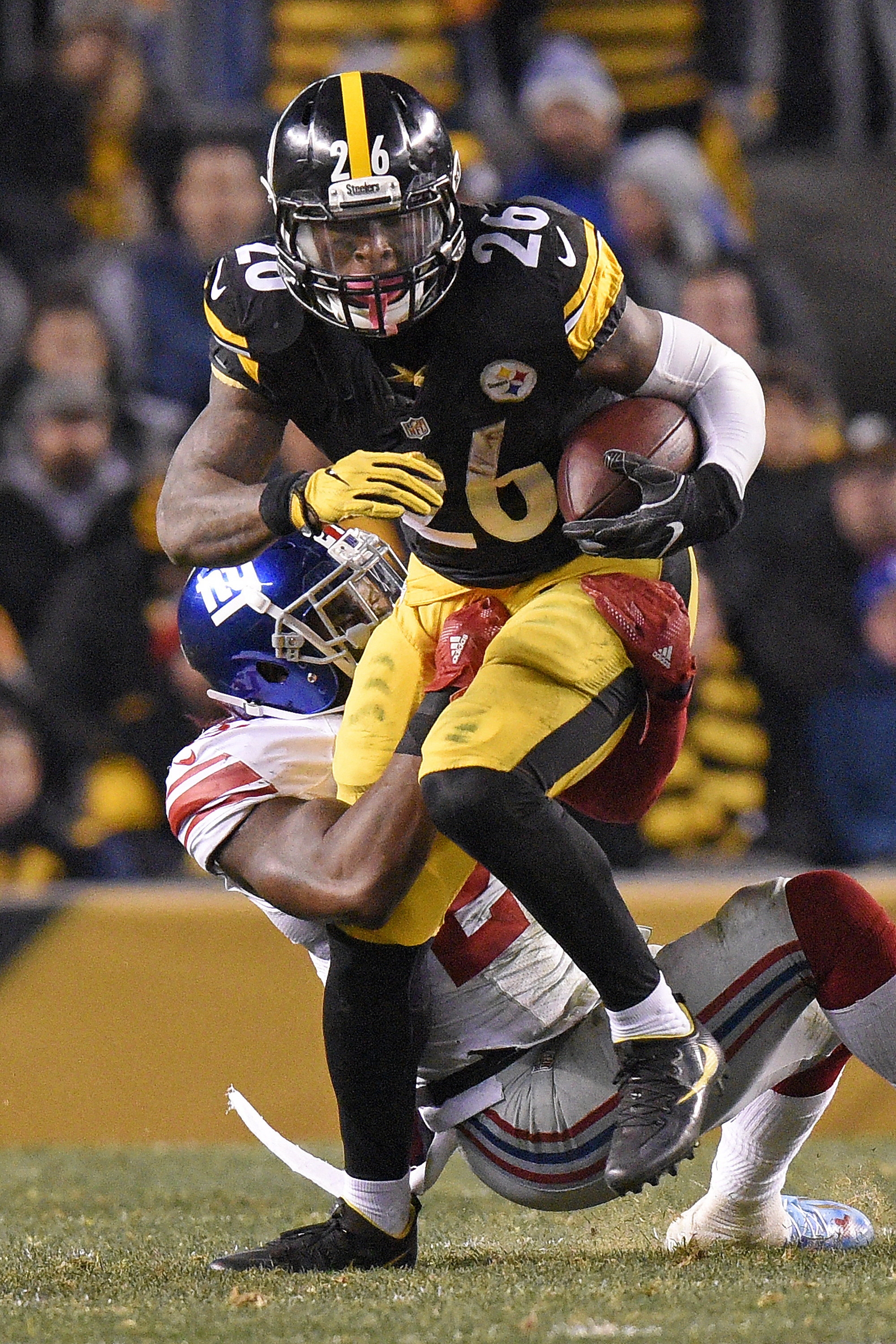 Pittsburgh Steelers running back Le'Veon Bell (26) is tackled by New York Giants strong safety Landon Collins (21) during the first half of an NFL football game in Pittsburgh, Sunday, Dec. 4, 2016. (AP Photo/Don Wright)