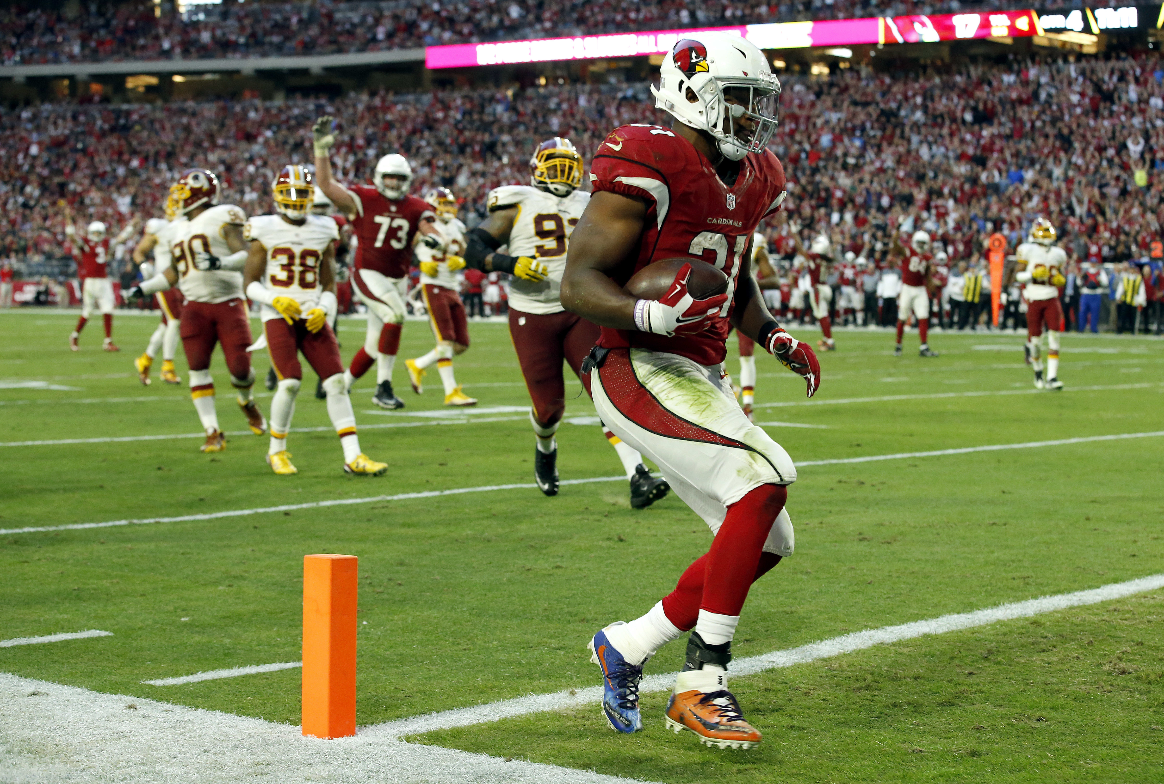 Arizona Cardinals running back David Johnson (31) scores a touchdown against the Washington Redskins during the second half of an NFL football game, Sunday, Dec. 4, 2016, in Glendale, Ariz. (AP Photo/Ross D. Franklin)
