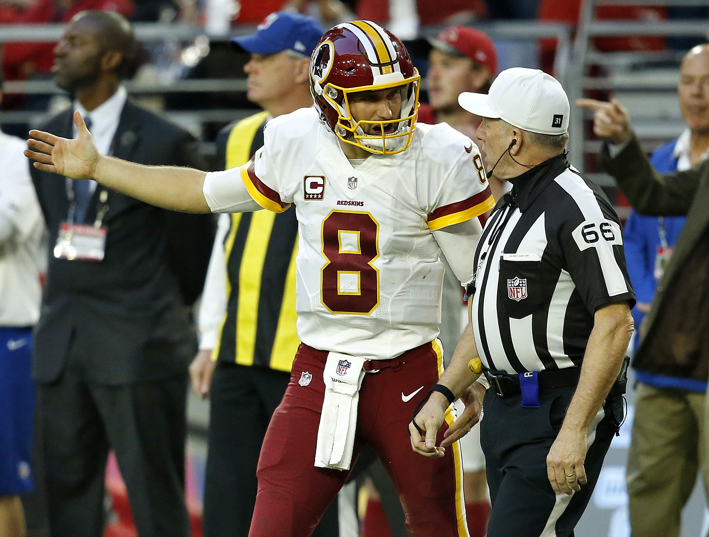 Washington Redskins quarterback Kirk Cousins (8) argues a call with referee Walt Anderson (66) during the second half of an NFL football game against the Arizona Cardinals, Sunday, Dec. 4, 2016, in Glendale, Ariz. (AP Photo/Ross D. Franklin)
