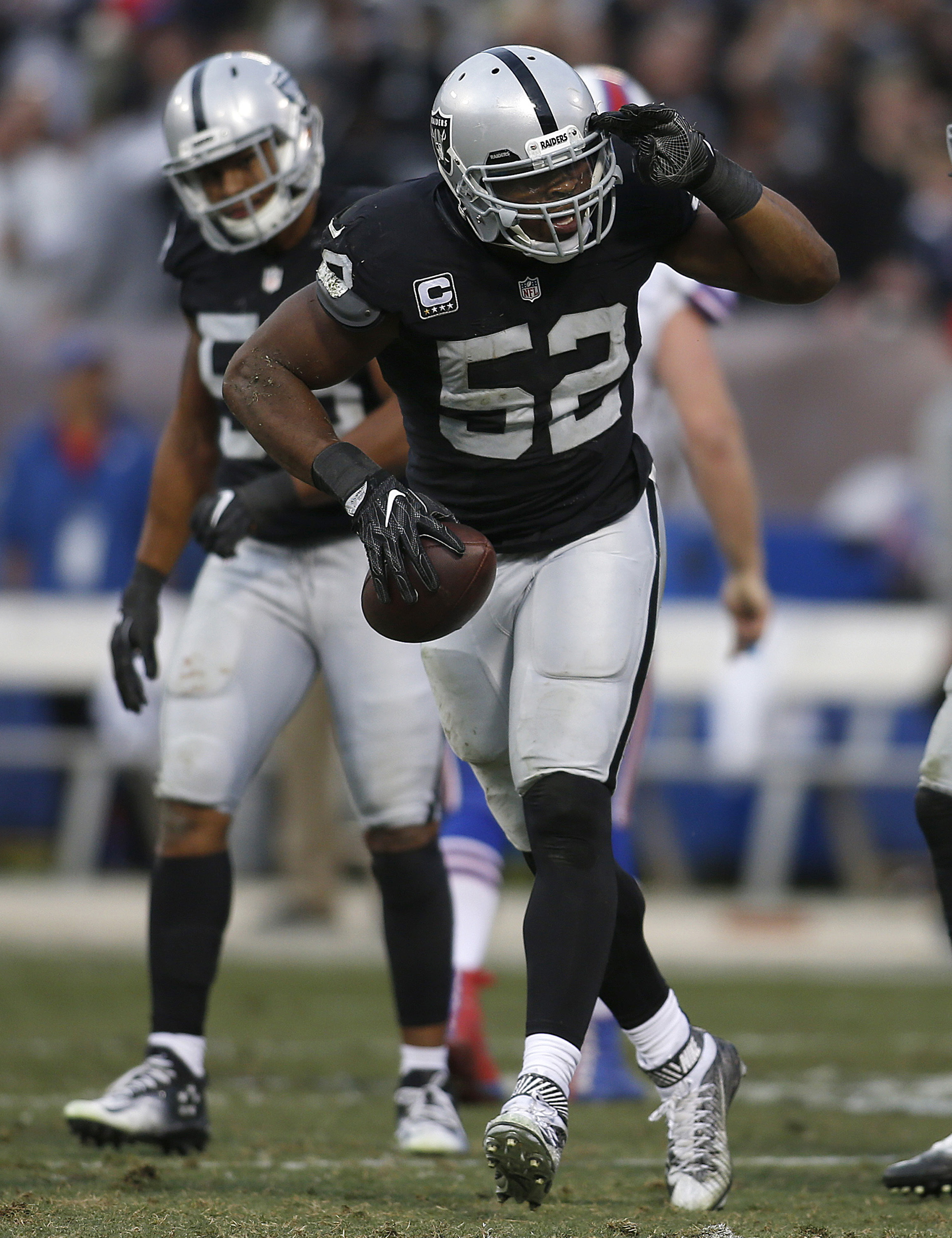 Oakland Raiders defensive end Khalil Mack (52) celebrates after recovering a fumble during the second half of an NFL football game against the Buffalo Bills in Oakland, Calif., Sunday, Dec. 4, 2016. The Raiders won 38-24. (AP Photo/D. Ross Cameron)