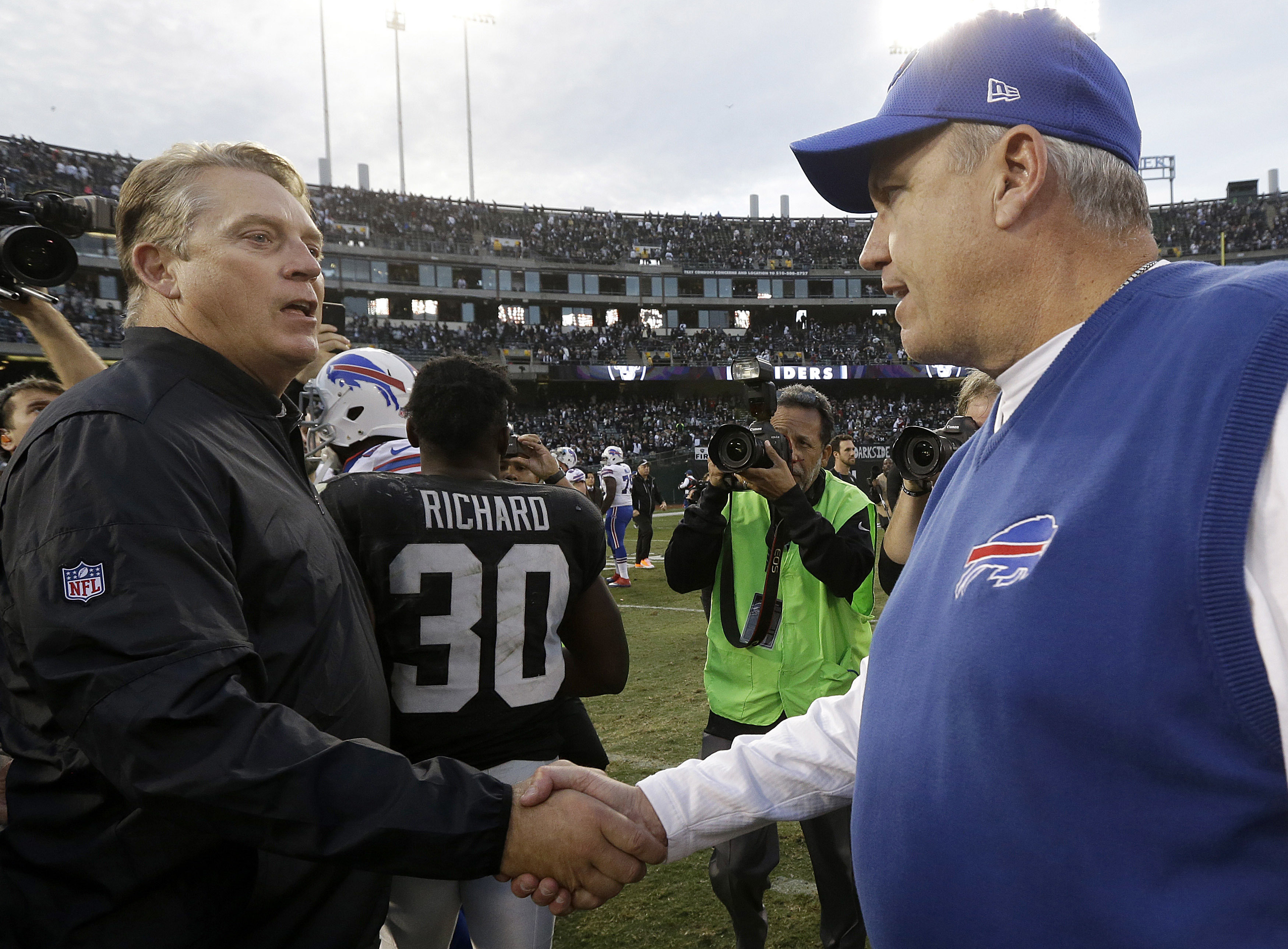 Oakland Raiders head coach Jack Del Rio, left, greets Buffalo Bills head coach Rex Ryan after an NFL football game in Oakland, Calif., Sunday, Dec. 4, 2016. The Raiders won 38-24. (AP Photo/Ben Margot)