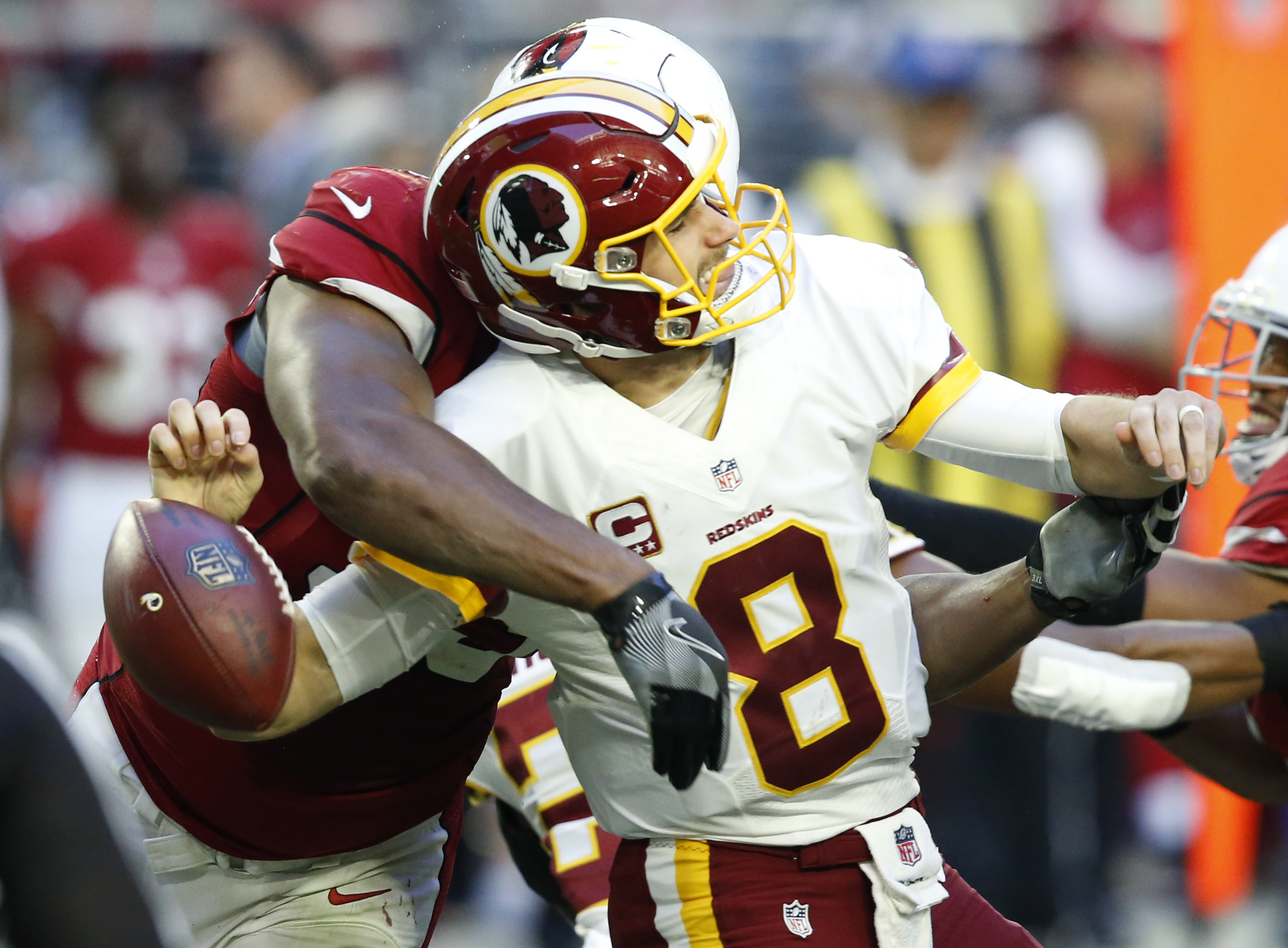 Arizona Cardinals defensive end Calais Campbell forces Washington Redskins quarterback Kirk Cousins (8) to fumble during the second half of an NFL football game, Sunday, Dec. 4, 2016, in Glendale, Ariz. The Cardinals recovered the ball on the play. (AP Ph