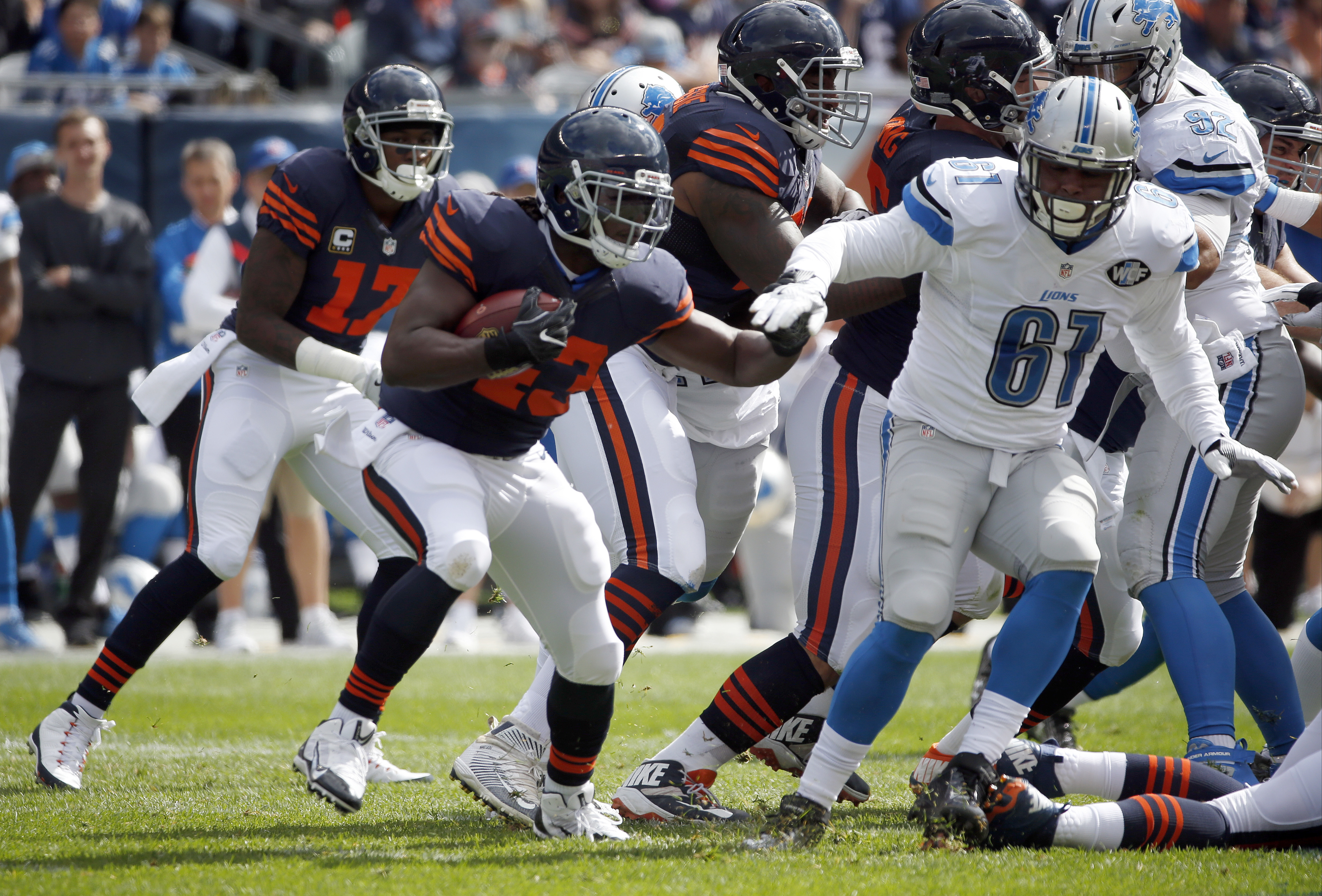 FILE - In this Oct. 2, 2016, file photo, Chicago Bears running back Joique Bell (43) runs against Detroit Lions defensive end Kerry Hyder (61) during the first half of an NFL football game in Chicago. Desperate for depth in the backfield, the Detroit Lion