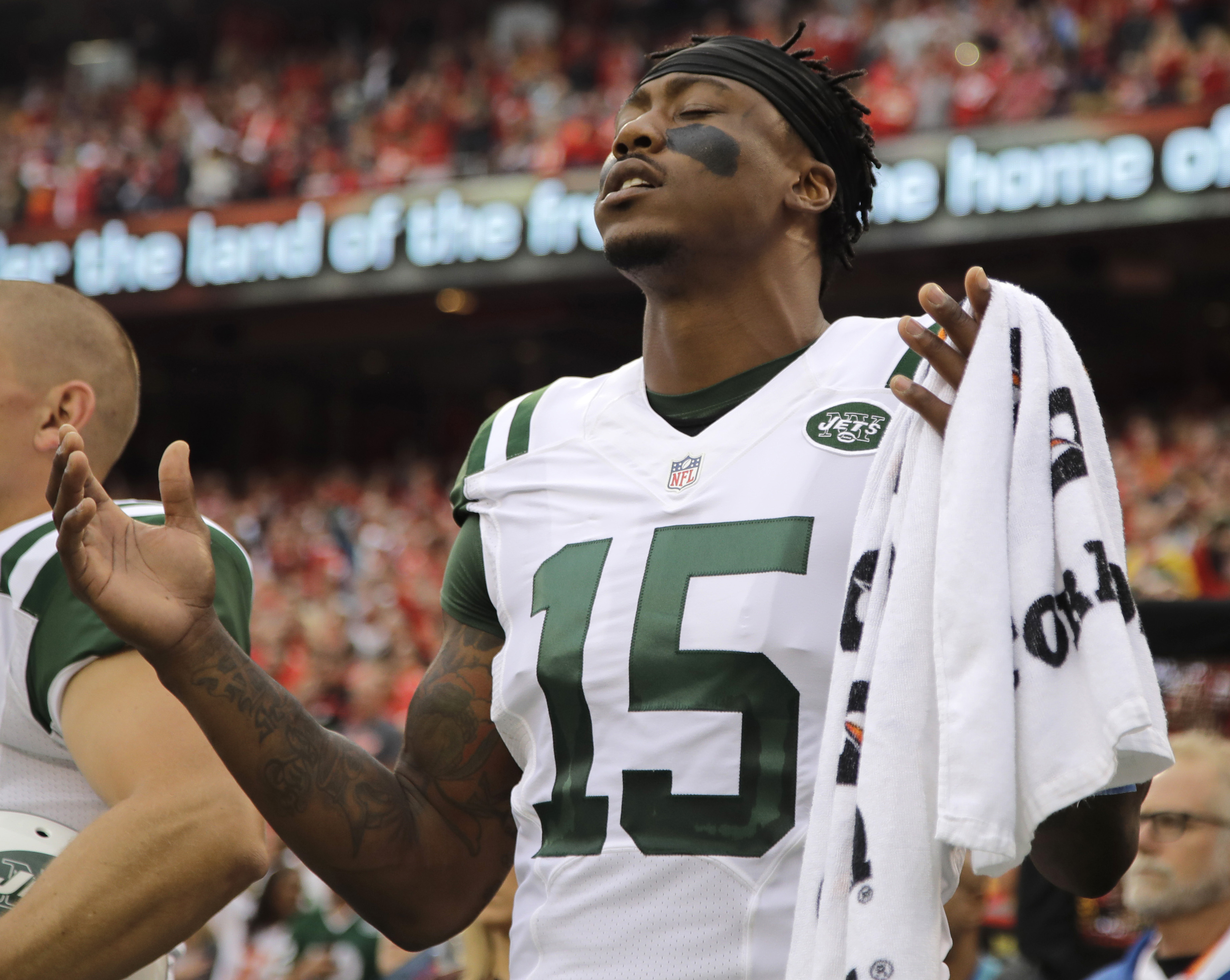 FILE - In this Sept. 25, 2016, file photo, New York Jets wide receiver Brandon Marshall (15) gestures during the playing of the national anthem before an NFL football game against the Kansas City Chiefs, in Kansas City, Mo. The Jets (3-9) take their four-