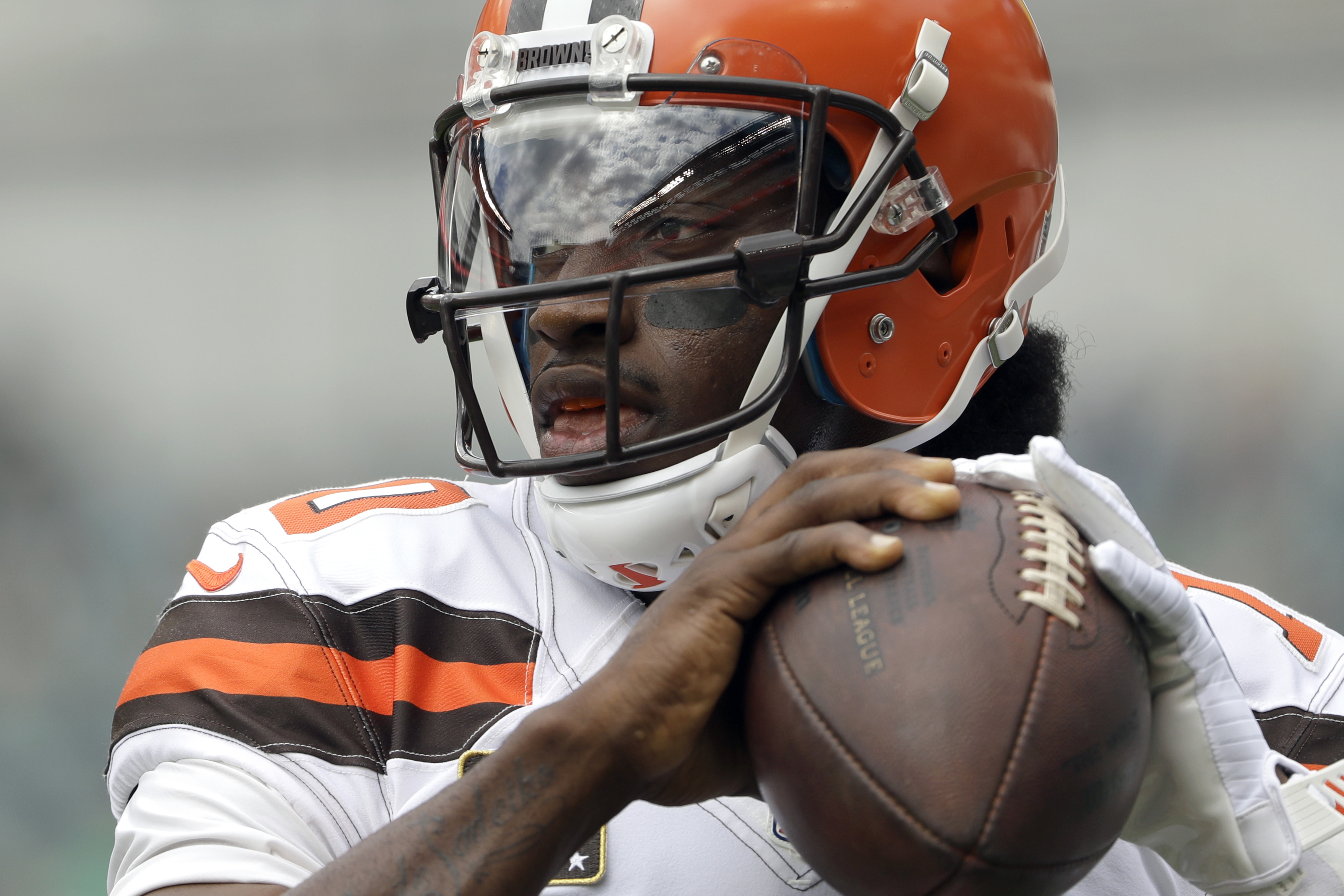 FILE - In this Sept. 11, 2016, file photo, Cleveland Browns' Robert Griffin III warms up before an NFL football game against the Philadelphia Eagles, in Philadelphia. Griffin III is back behind center for the Browns. Griffin will make his second start thi