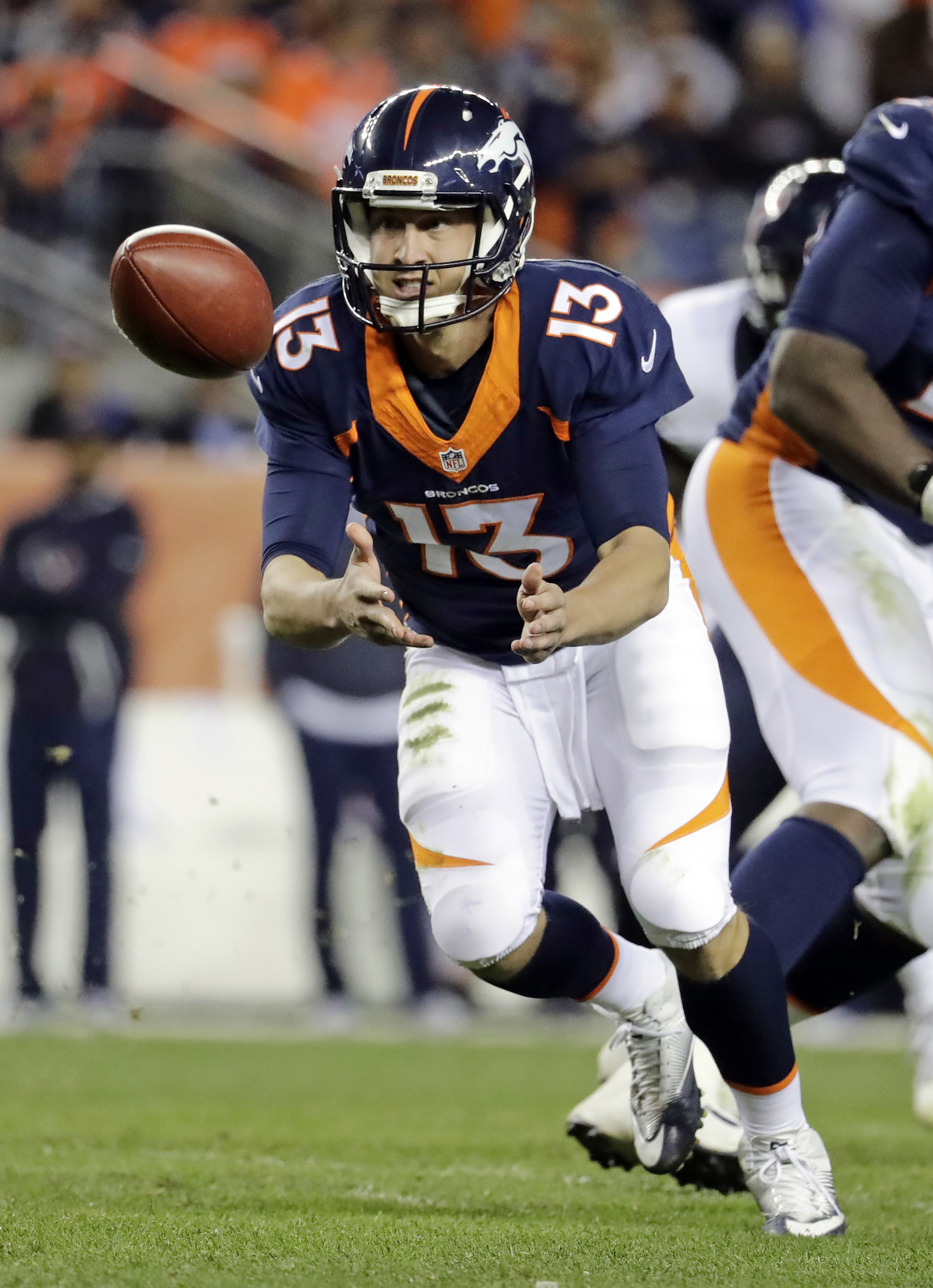 FILE - In this Oct. 24, 2016, file photo, Denver Broncos quarterback Trevor Siemian pitches the ball against the Houston Texans during the second half of an NFL football game,  in Denver.  The defending Super Bowl champion Denver Broncos need a win Sunday