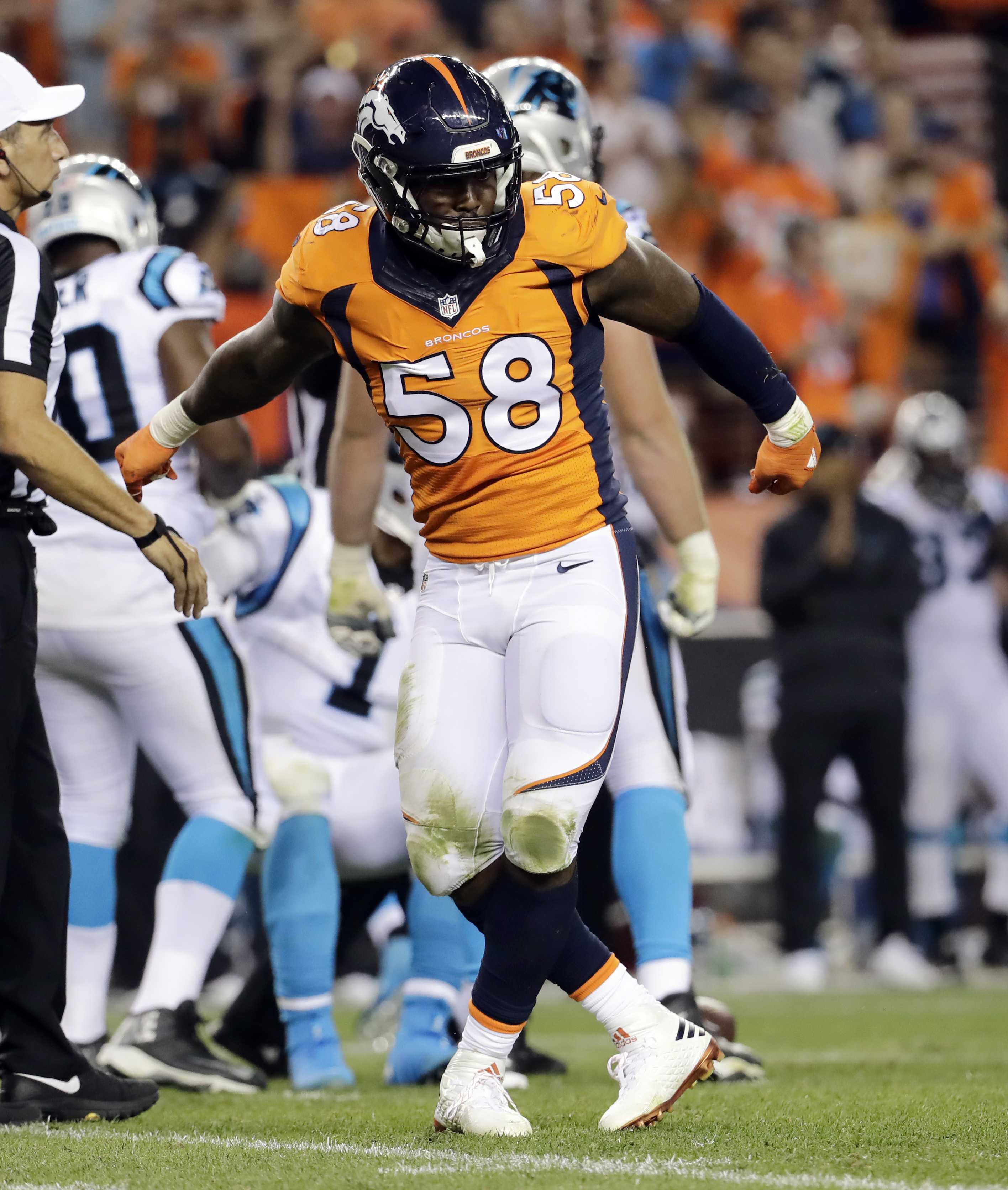 FILE - In this Sept. 8, 2016, file photo, Denver Broncos outside linebacker Von Miller (58) celebrates his sack against the Carolina Panthers during the second half of an NFL football game, in Denver. Von Miller's lead-leading sack total jumped to 13. The