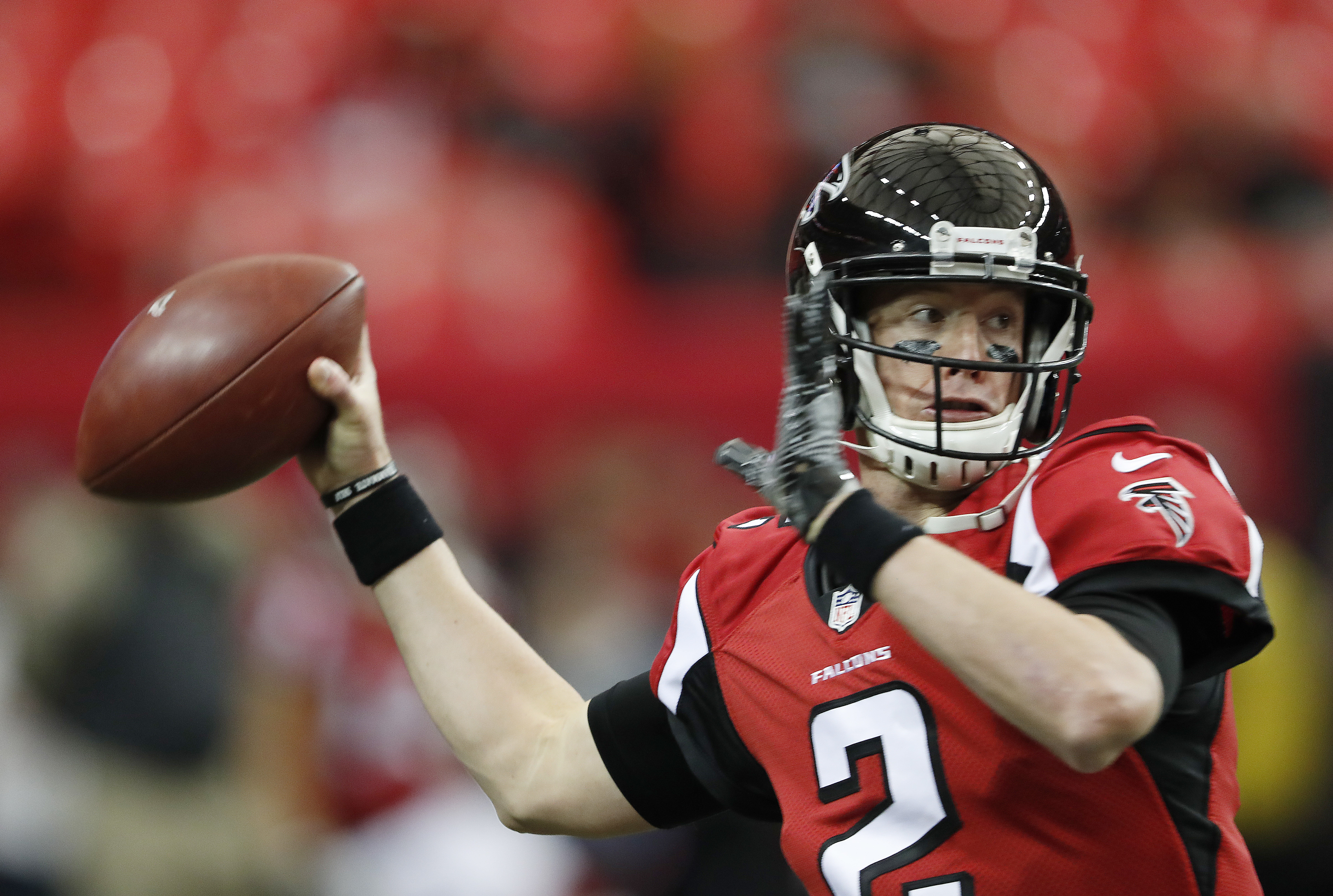 FILE - In this Sunday, Nov. 27, 2016 file photo, Atlanta Falcons quarterback Matt Ryan (2) warms up before the first of an NFL football game between the Atlanta Falcons and the Arizona Cardinals in Atlanta. When Jared Goff was preparing to become the No.