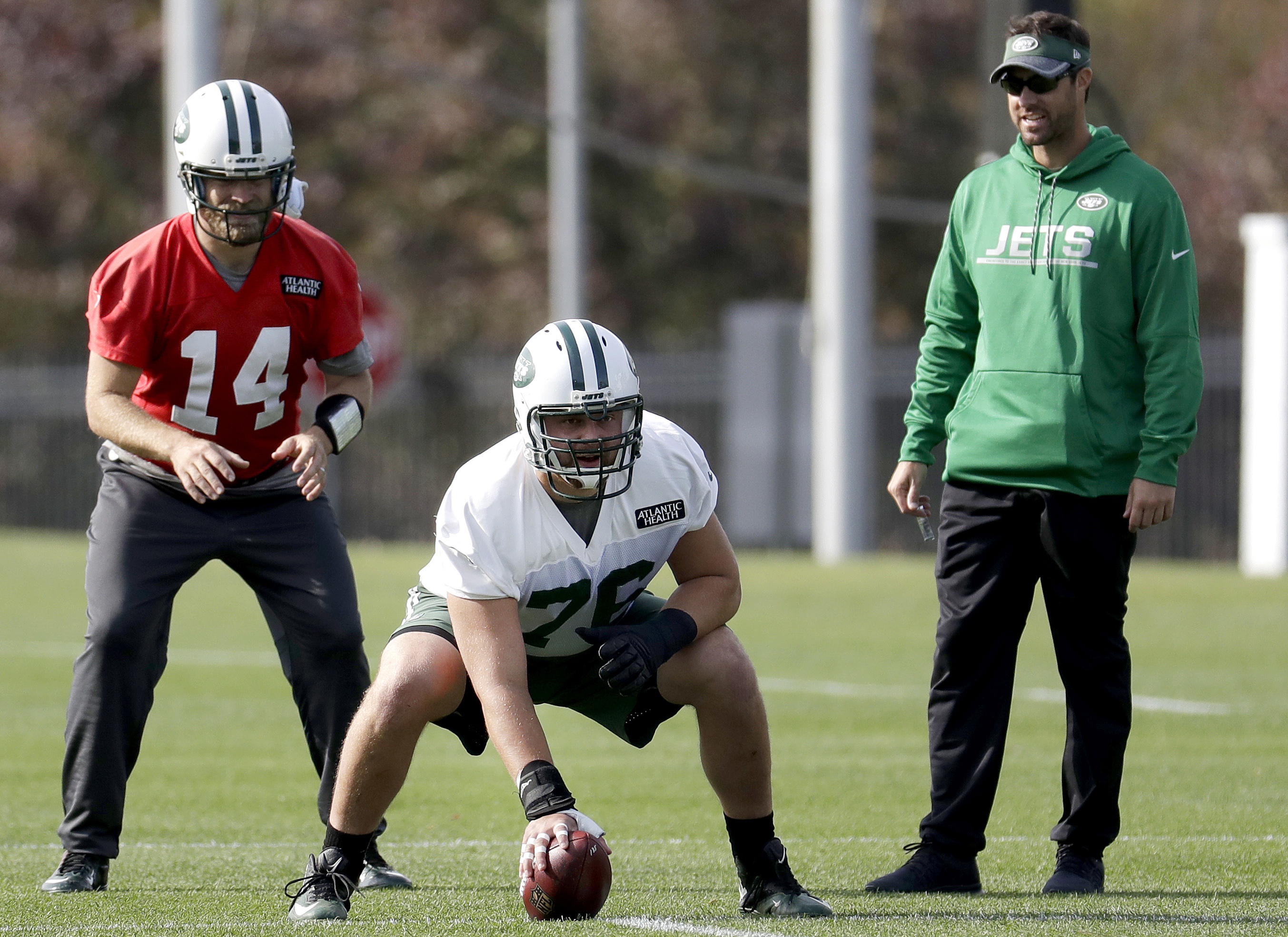 FILE - In this Nov. 2, 2016, file photo, New York Jets' Ryan Fitzpatrick, left, prepares for the snap from center Wesley Johnson during NFL football practice in Florham Park, N.J. Johnson is about to get lots more playing time for the Jets as he replaces