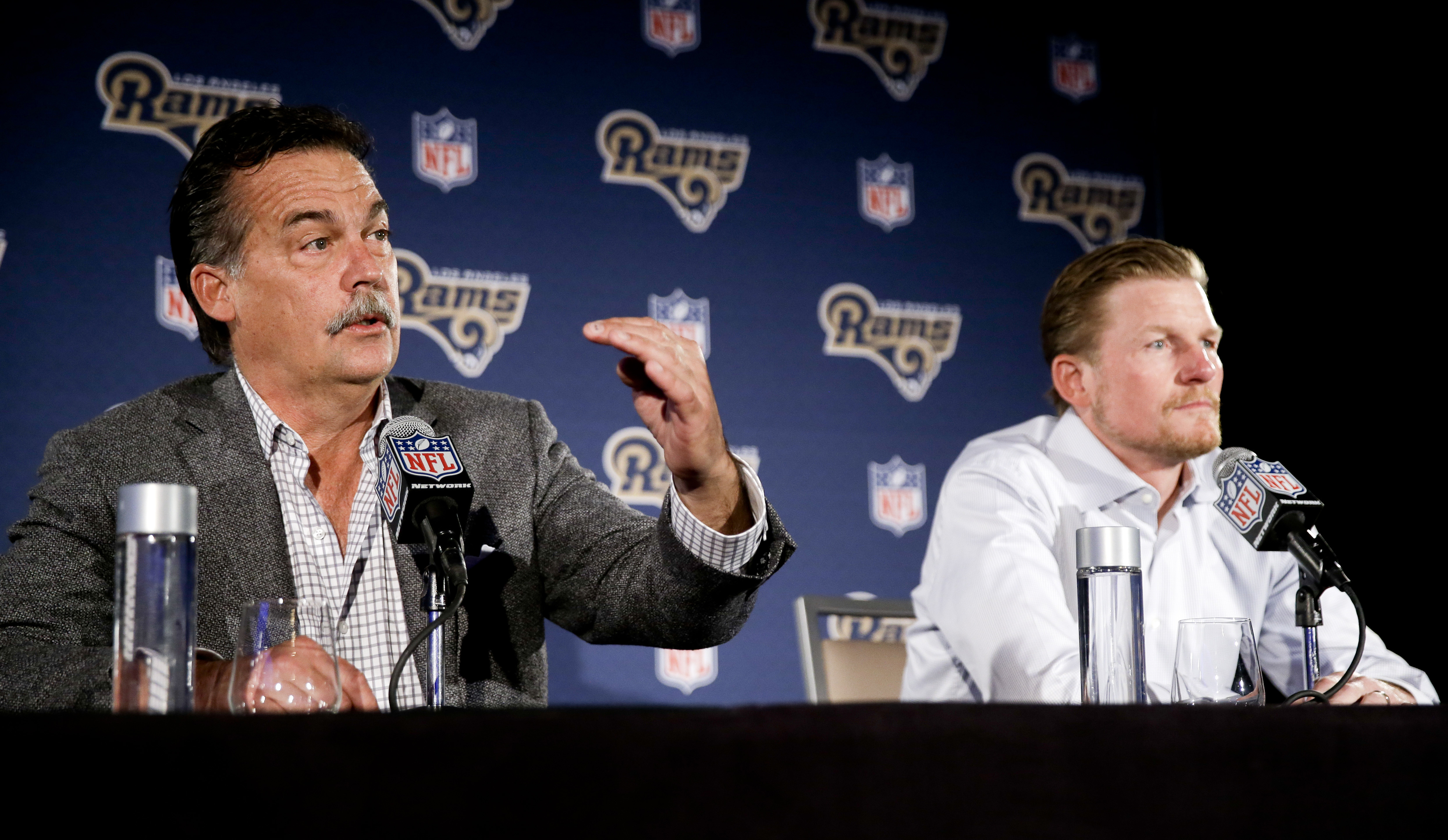 FILE - In this April 26, 2016, file photo, Los Angeles Rams general manager Les Snead, right, listens as head coach Jeff Fisher talks about their NFL football draft process during a news conference in Los Angeles. Fisher and Snead dismissed widespread spe