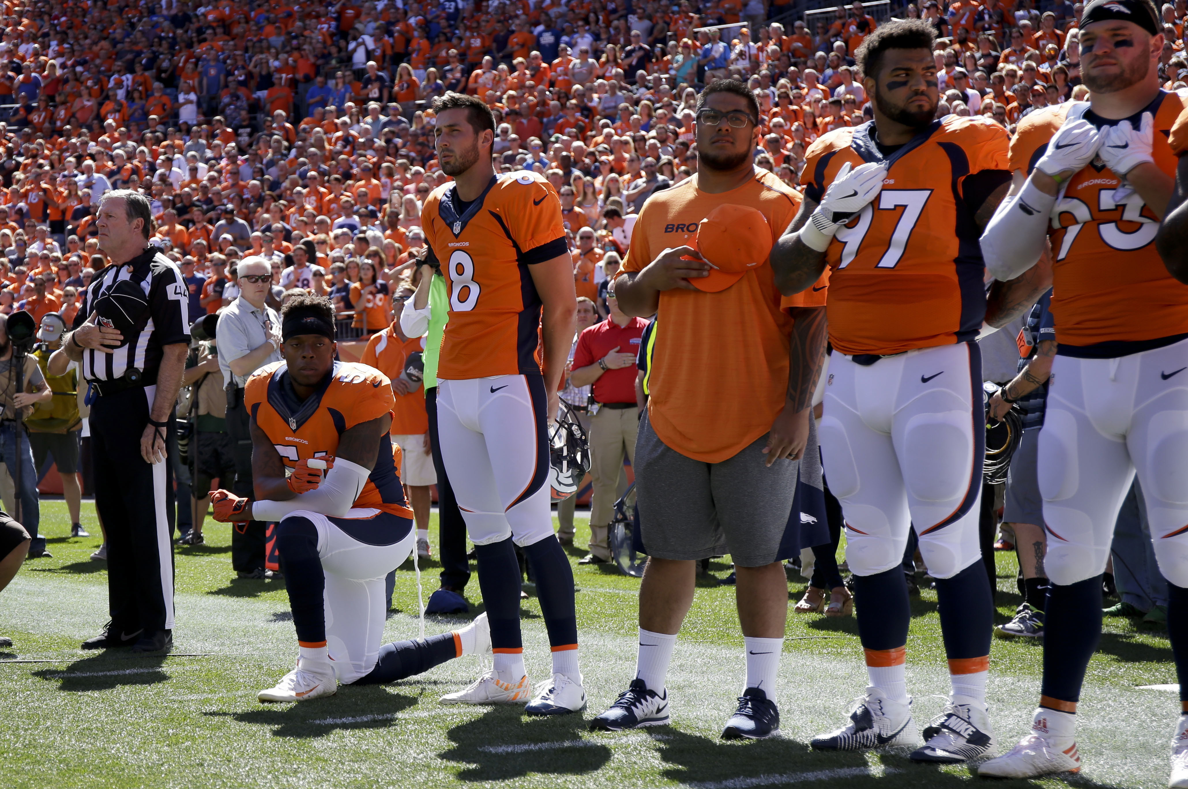 FILE - In this Sept. 18, 2016, file photo, Denver Broncos inside linebacker Brandon Marshall takes a knee during the national anthem before an NFL football game against the Indianapolis Colts in Denver. Marshall posted a racist, threatening letter he rece