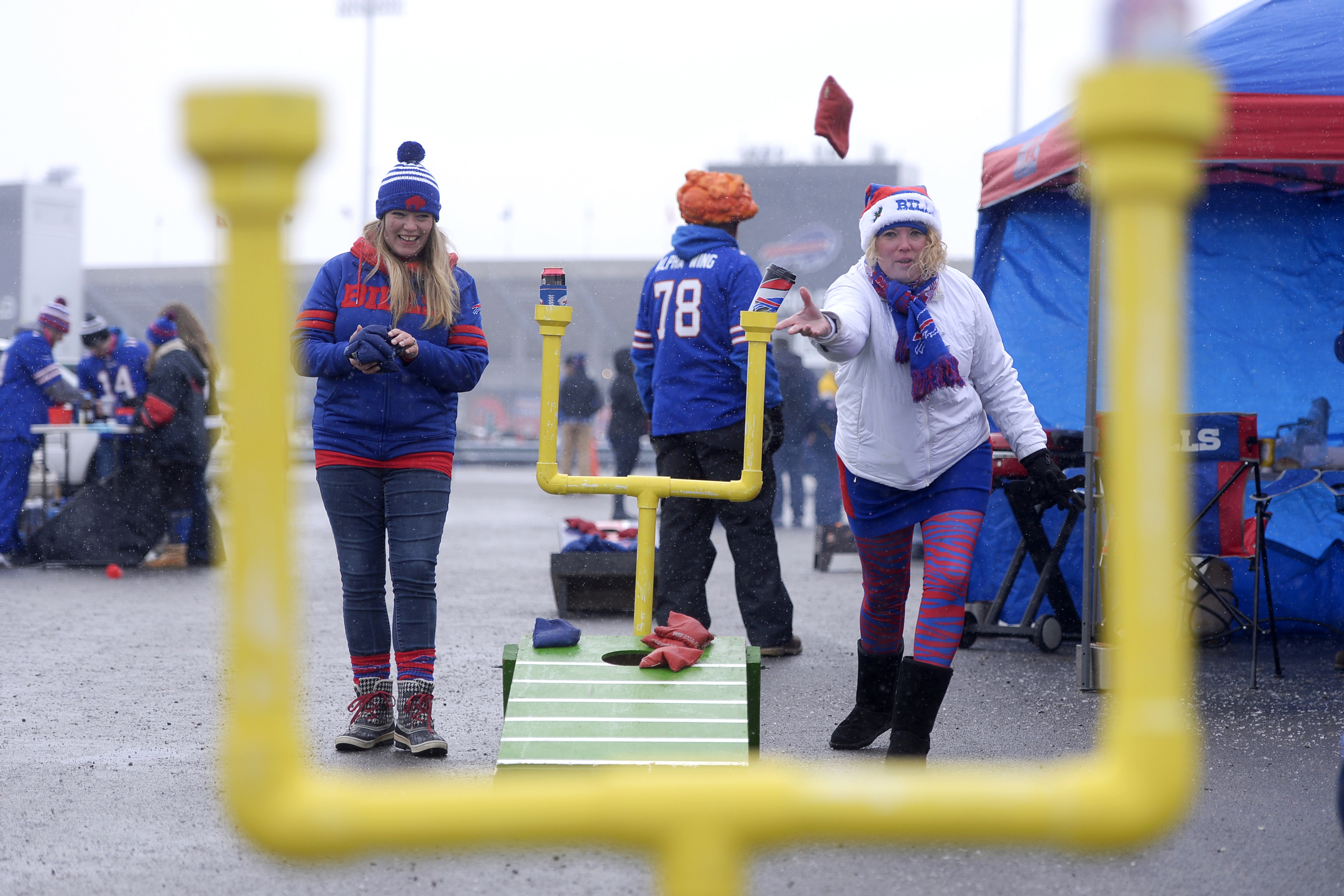 Jill Huffnagle, left, of Lockport, N.Y., and Lisa Lyons, of Amherst, N.Y., play a game while tailgating prior to an NFL football game between the Buffalo Bills and the Pittsburgh Steelers, Sunday, Dec. 11, 2016, in Orchard Park, N.Y. (AP Photo/Adrian Krau