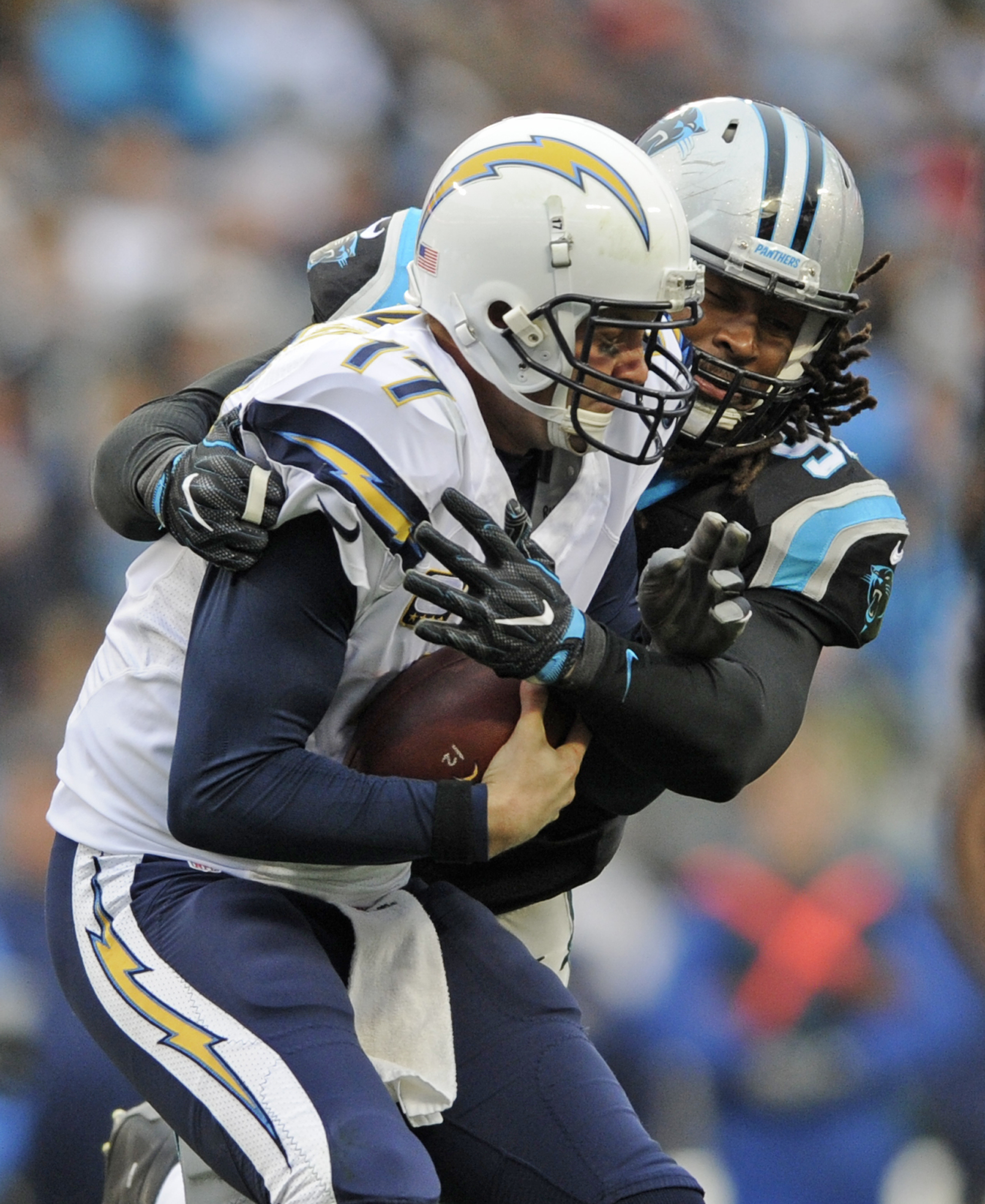 San Diego Chargers' Philip Rivers (17) is sacked by Carolina Panthers' Ryan Delaire (91) in the first half of an NFL football game in Charlotte, N.C., Sunday, Dec. 11, 2016. (AP Photo/Mike McCarn)