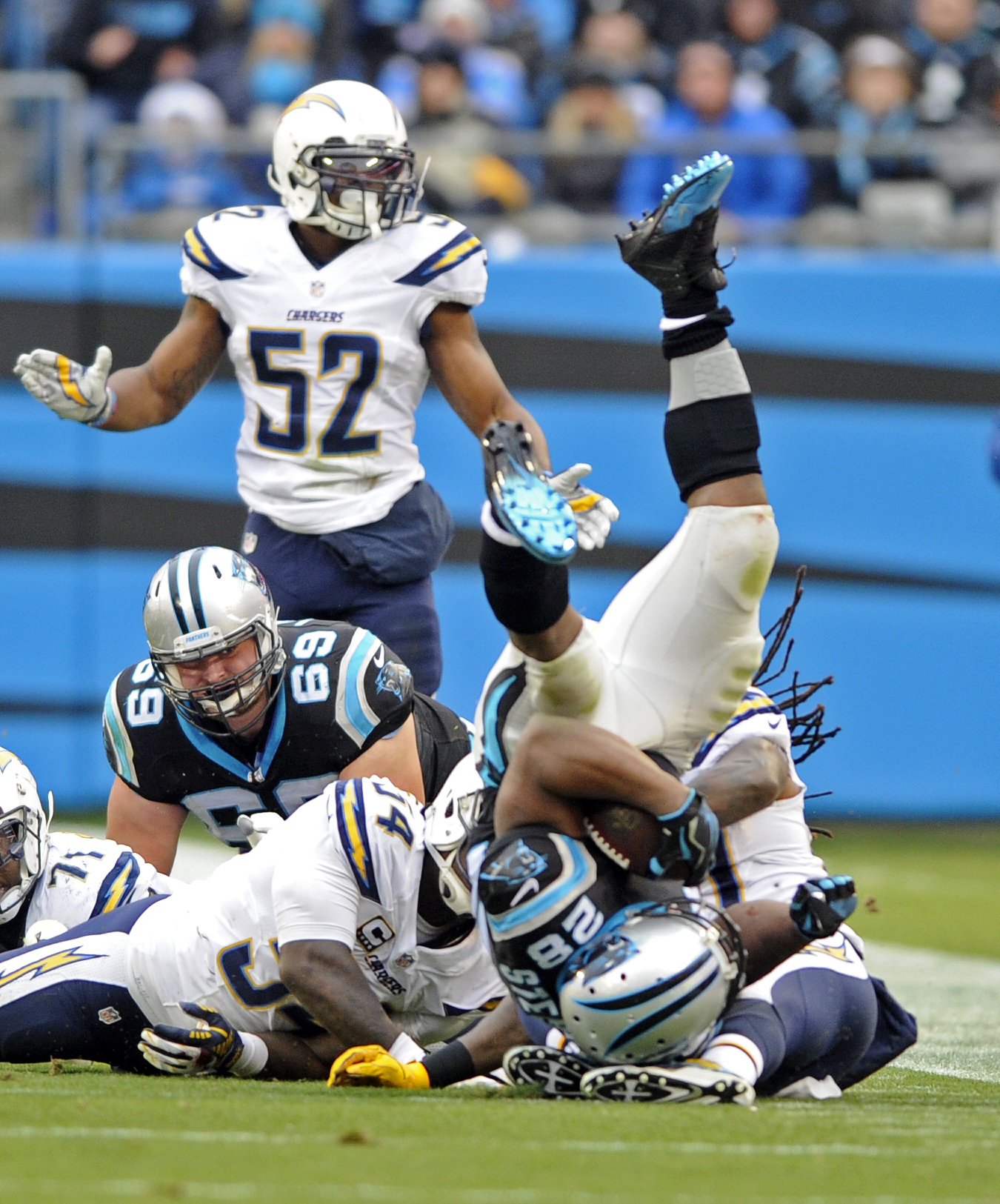 Carolina Panthers' Jonathan Stewart (28) rolls over a San Diego Chargers player in the first half of an NFL football game in Charlotte, N.C., Sunday, Dec. 11, 2016. (AP Photo/Mike McCarn)