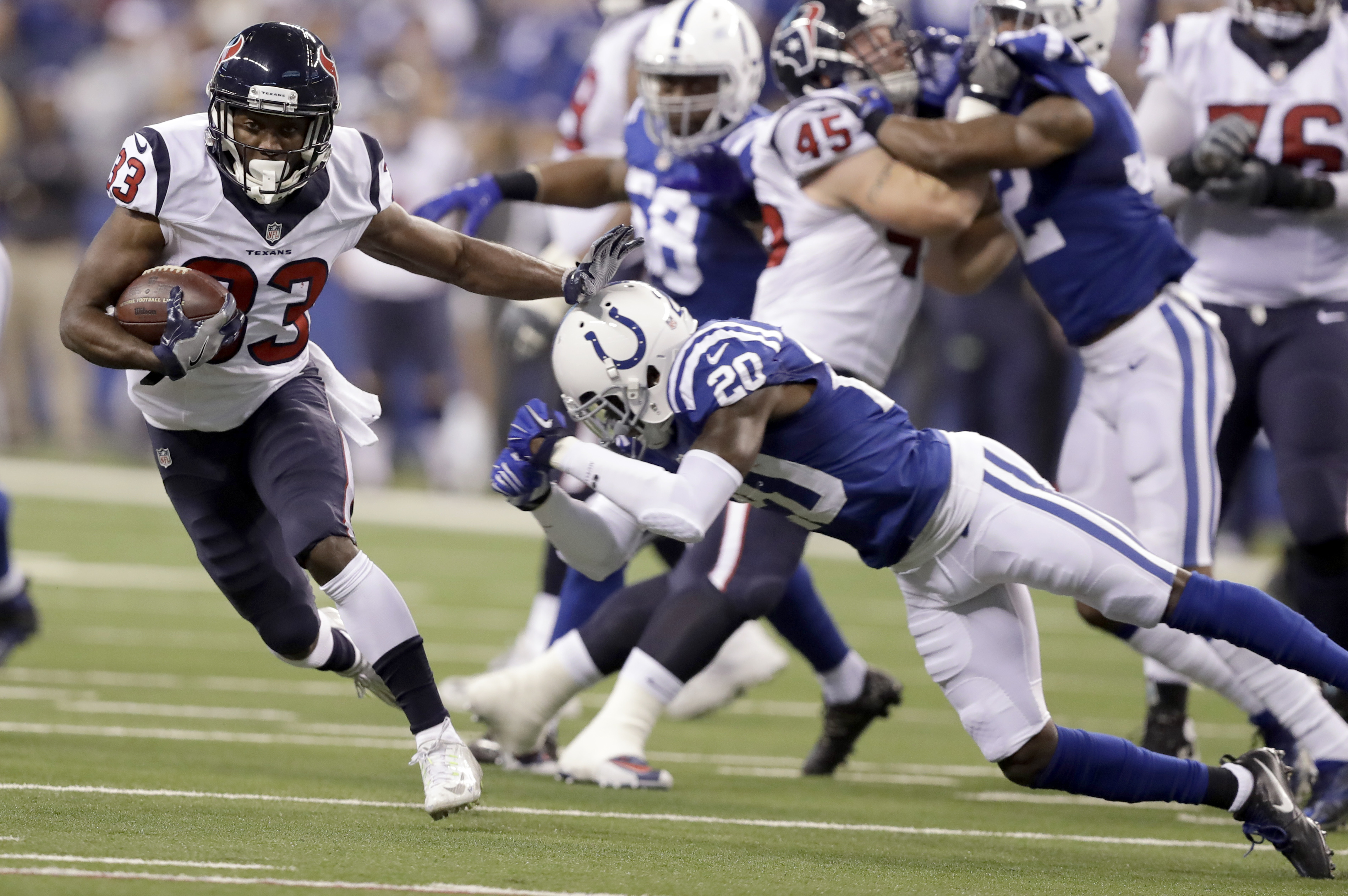Houston Texans running back Akeem Hunt (33) runs with the ball past Indianapolis Colts cornerback Darius Butler (20) during the first half of an NFL football game Sunday, Dec. 11, 2016, in Indianapolis. (AP Photo/Darron Cummings)