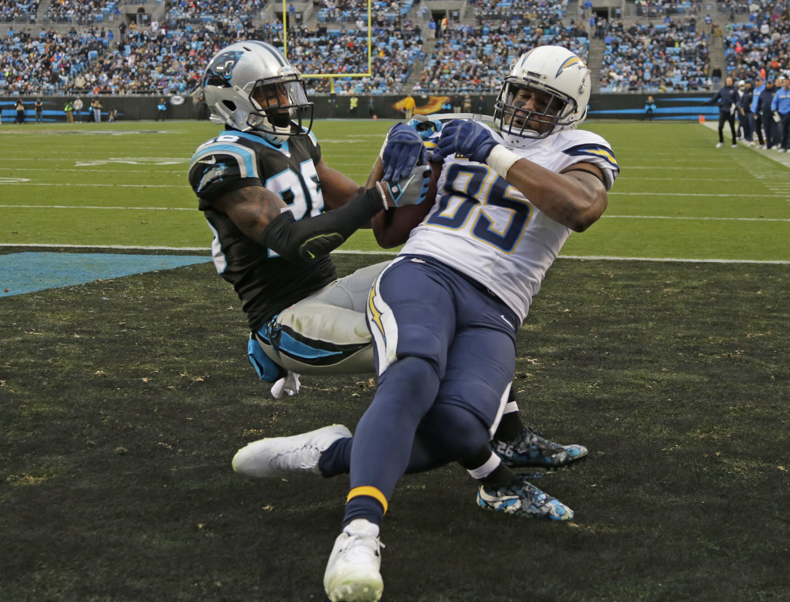 San Diego Chargers' Antonio Gates (85) drops a two-point conversion pass attempt as Carolina Panthers' Daryl Worley (26) defends in the second half of an NFL football game in Charlotte, N.C., Sunday, Dec. 11, 2016. (AP Photo/Bob Leverone)