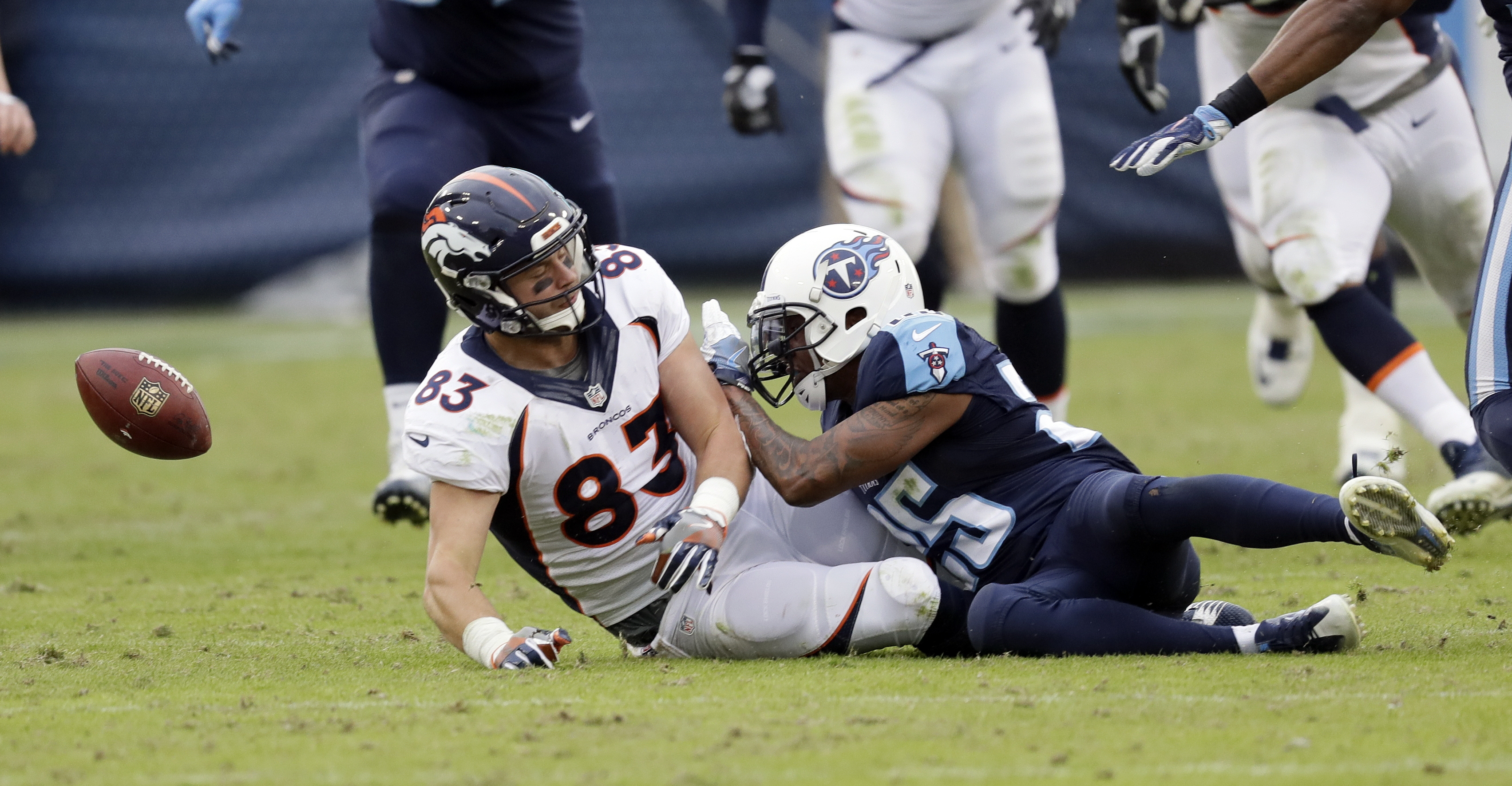 Denver Broncos tight end A.J. Derby (83) fumbles the ball as Tennessee Titans defensive back Rashad Johnson (25) closes in during the final minutes of the fourth quarter of an NFL football game Sunday, Dec. 11, 2016, in Nashville, Tenn. The Titans recover