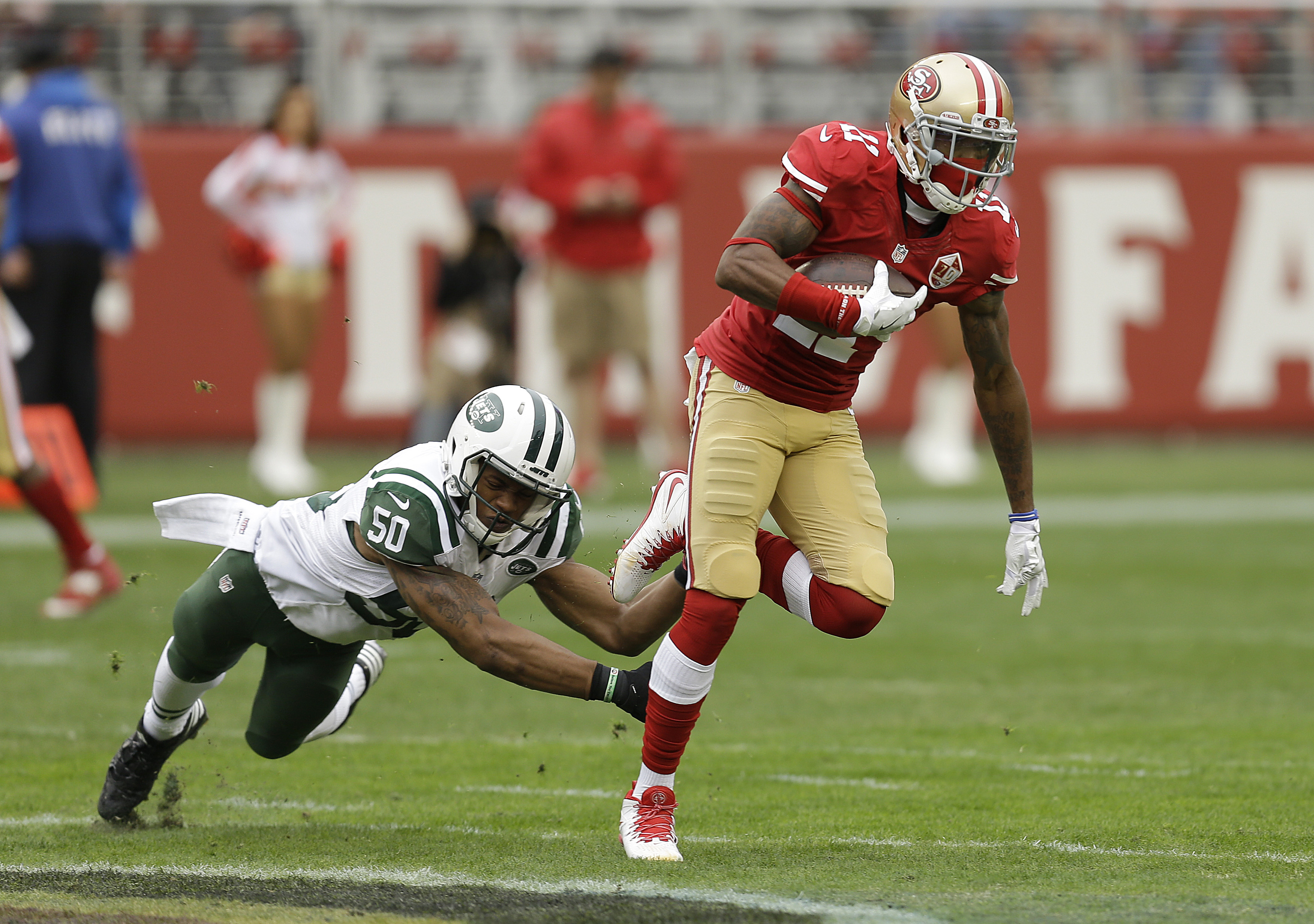 San Francisco 49ers wide receiver Quinton Patton (11) runs from New York Jets outside linebacker Darron Lee (50) during the first half of an NFL football game in Santa Clara, Calif., Sunday, Dec. 11, 2016. (AP Photo/Ben Margot)