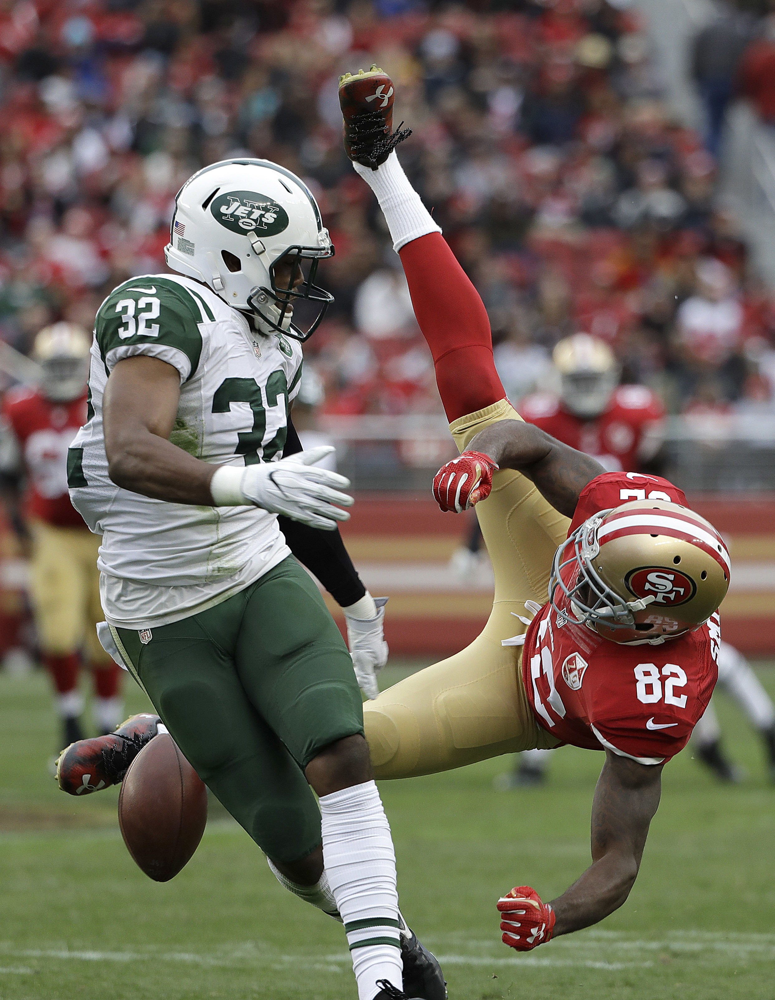 San Francisco 49ers wide receiver Torrey Smith (82) cannot catch a pass while defended by New York Jets cornerback Juston Burris (32) during the second half of an NFL football game in Santa Clara, Calif., Sunday, Dec. 11, 2016. (AP Photo/Marcio Jose Sanch
