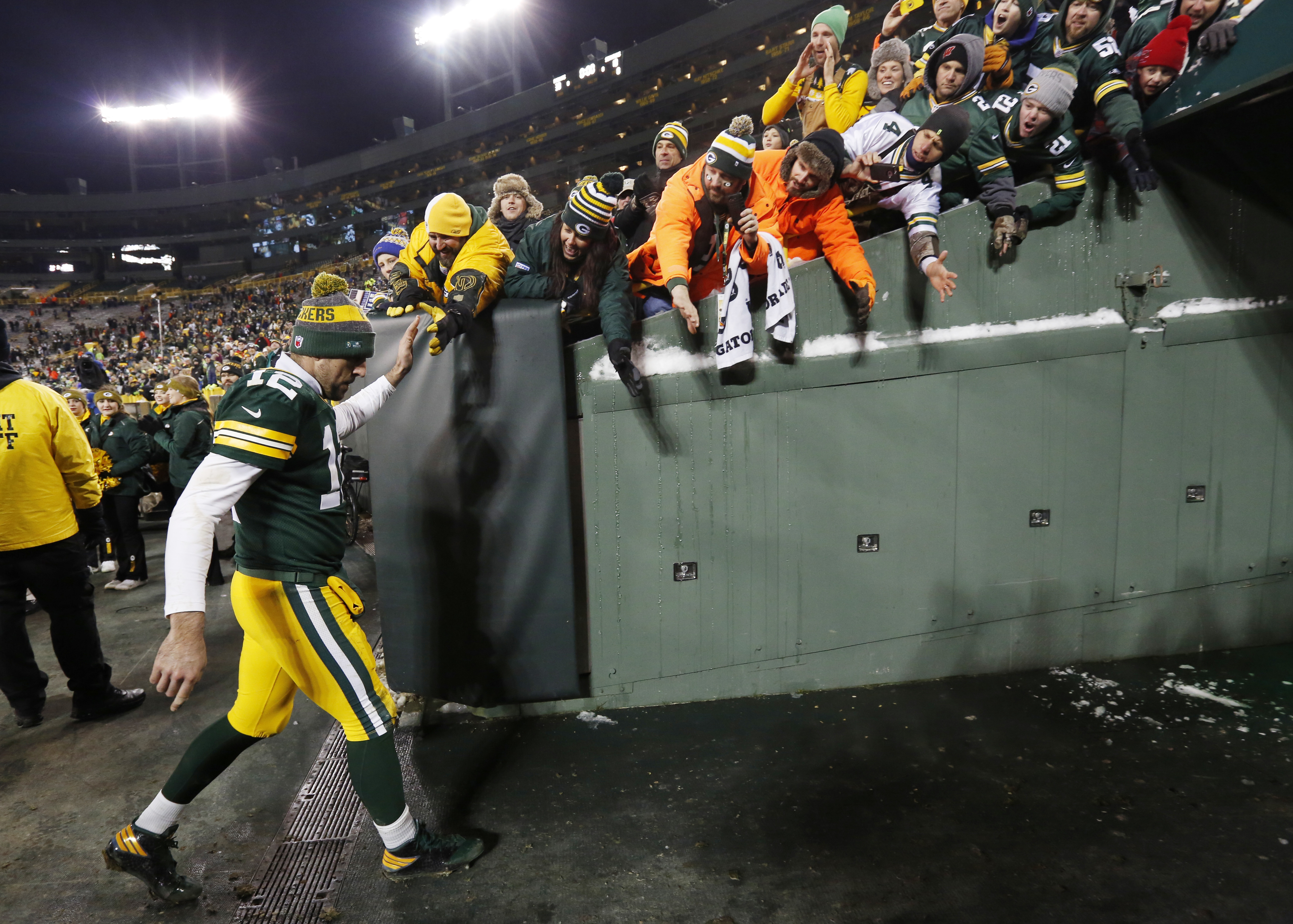 Green Bay Packers' Aaron Rodgers walks off the field after an NFL football game against the Seattle Seahawks Sunday, Dec. 11, 2016, in Green Bay, Wis. The Packers won 38-10. (AP Photo/Mike Roemer)