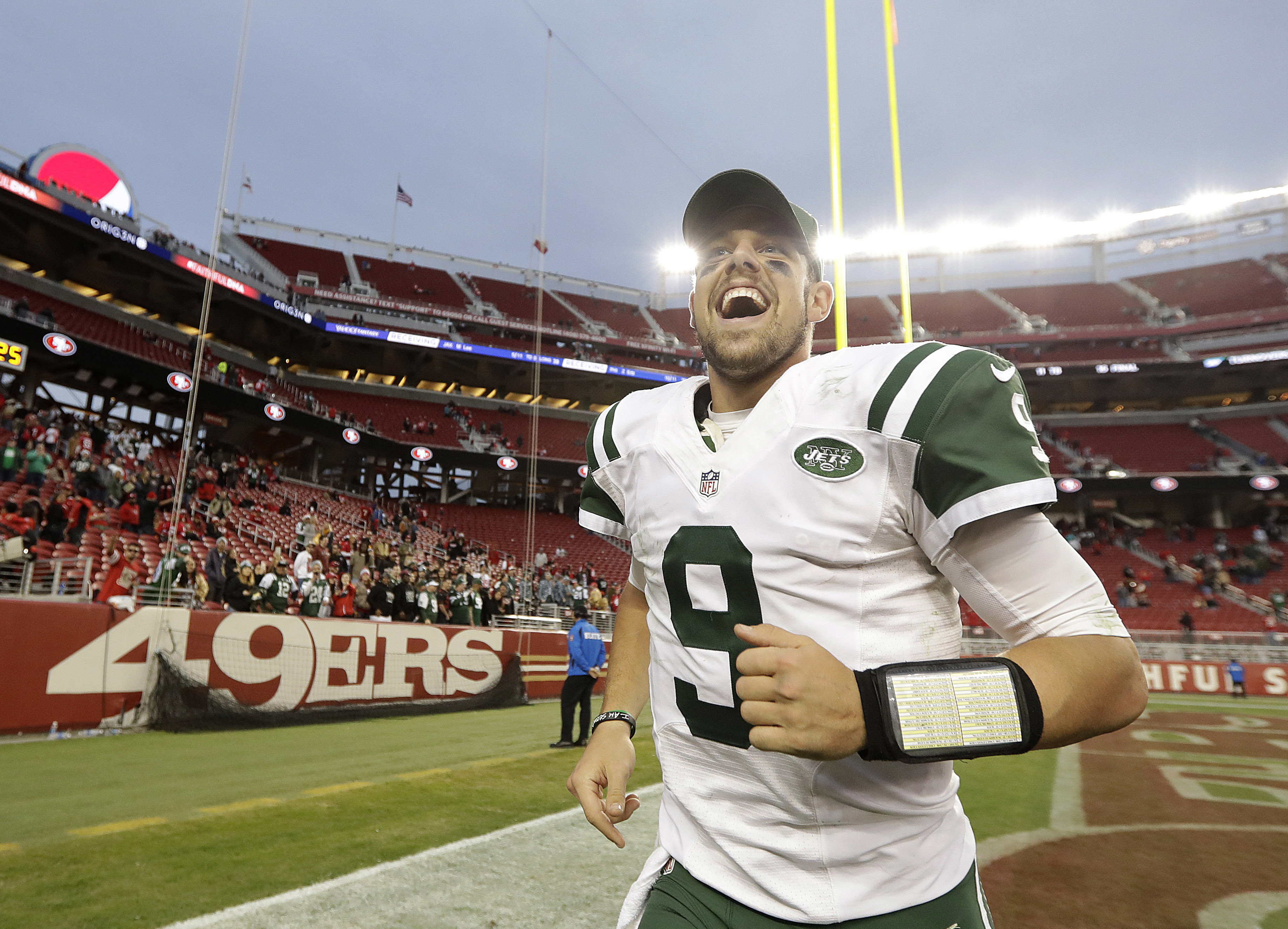 New York Jets quarterback Bryce Petty (9) smiles as he runs off the field after the Jets defeated the San Francisco 49ers 23-17 in overtime of an NFL football game in Santa Clara, Calif., Sunday, Dec. 11, 2016. (AP Photo/Marcio Jose Sanchez)