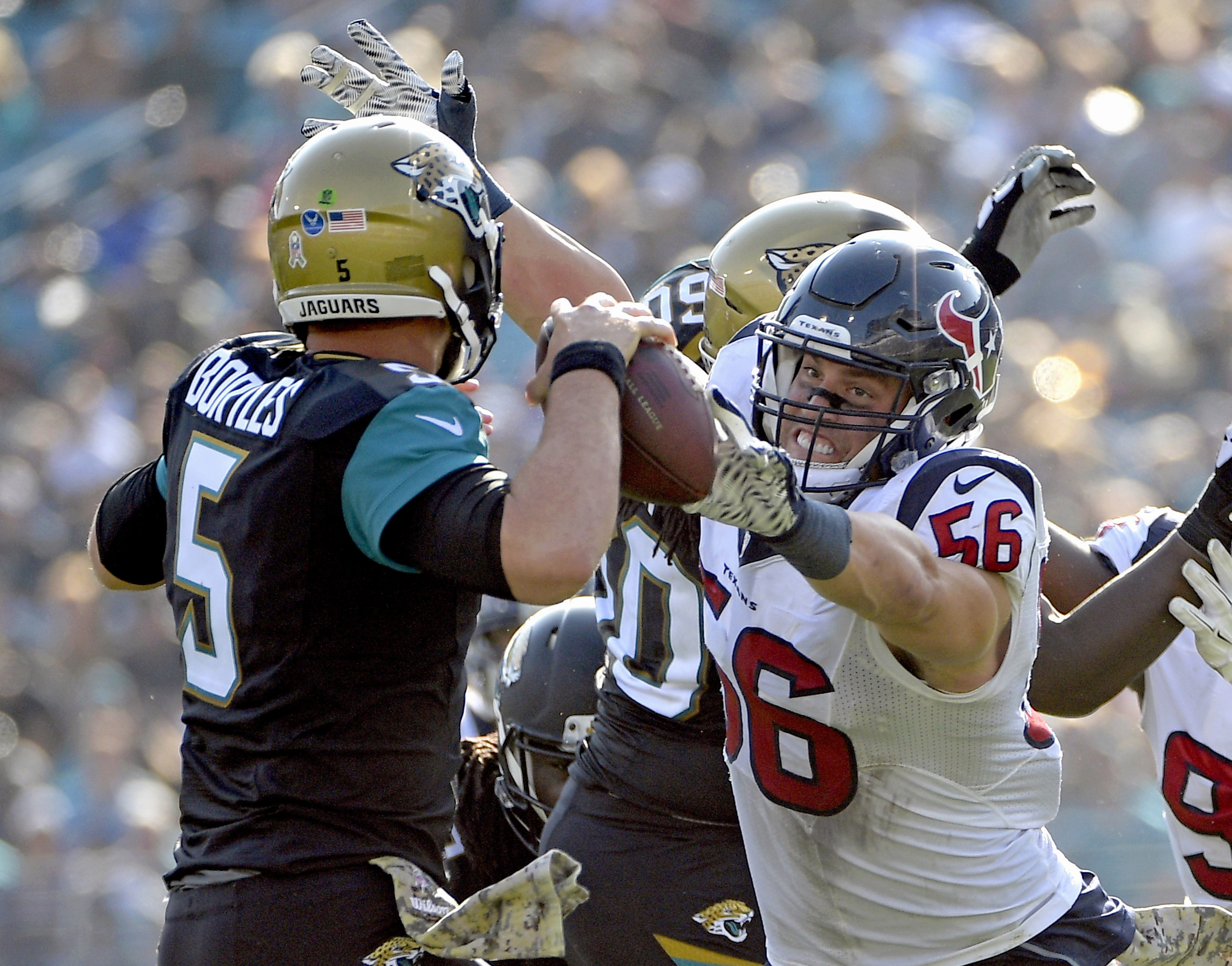 FILE - In this Nov. 13, 2016, file photo, Houston Texans inside linebacker Brian Cushing (56) pressures Jacksonville Jaguars quarterback Blake Bortles (5) as he throws a pass during the second half of an NFL football game, in Jacksonville, Fla Cushing is