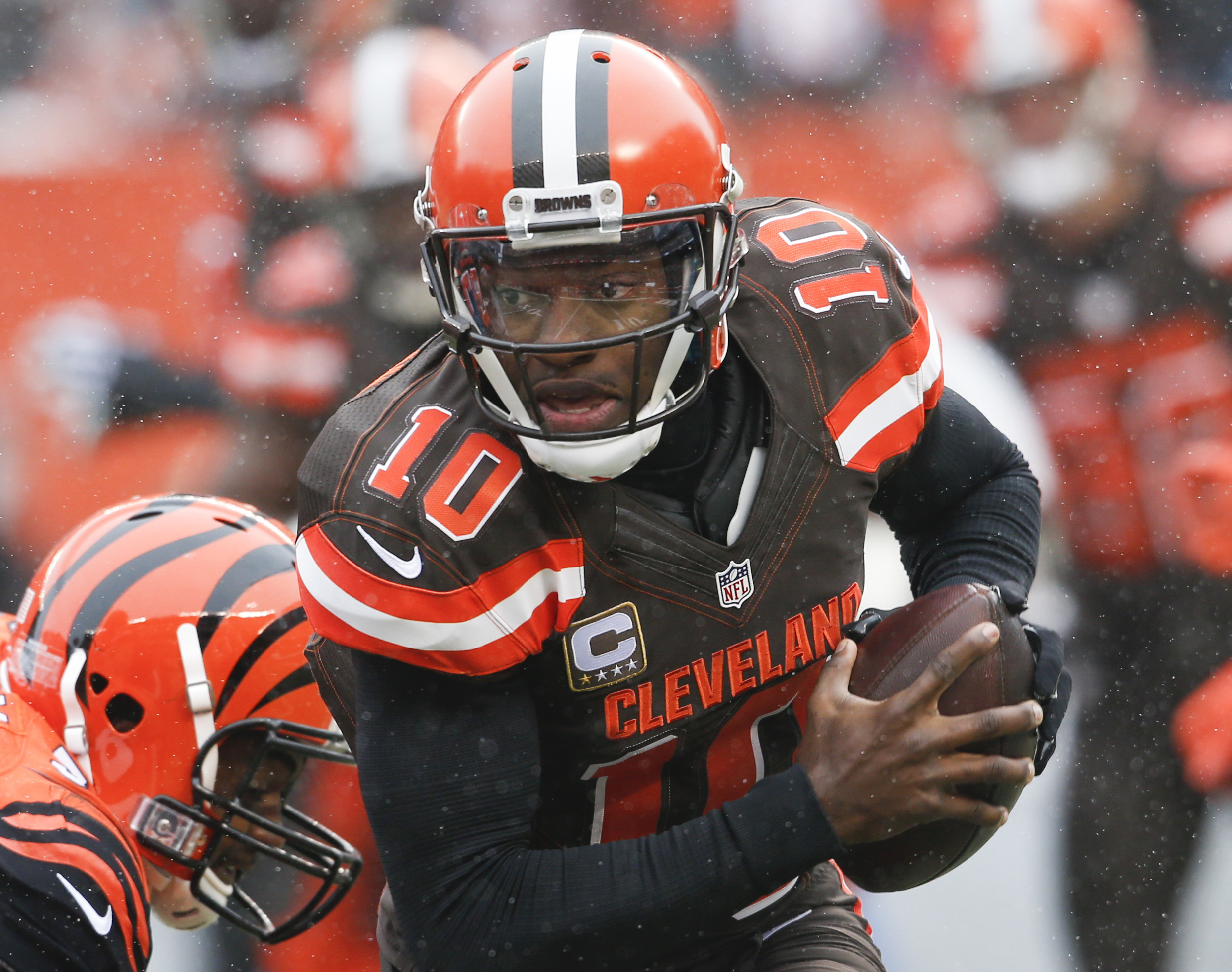 FILE - In this Dec. 11, 2016, file photo, Cleveland Browns quarterback Robert Griffin III runs in the first half of an NFL football game against the Cincinnati Bengals, in Cleveland. Browns coach Hue Jackson said Griffin III needs to be better this week i