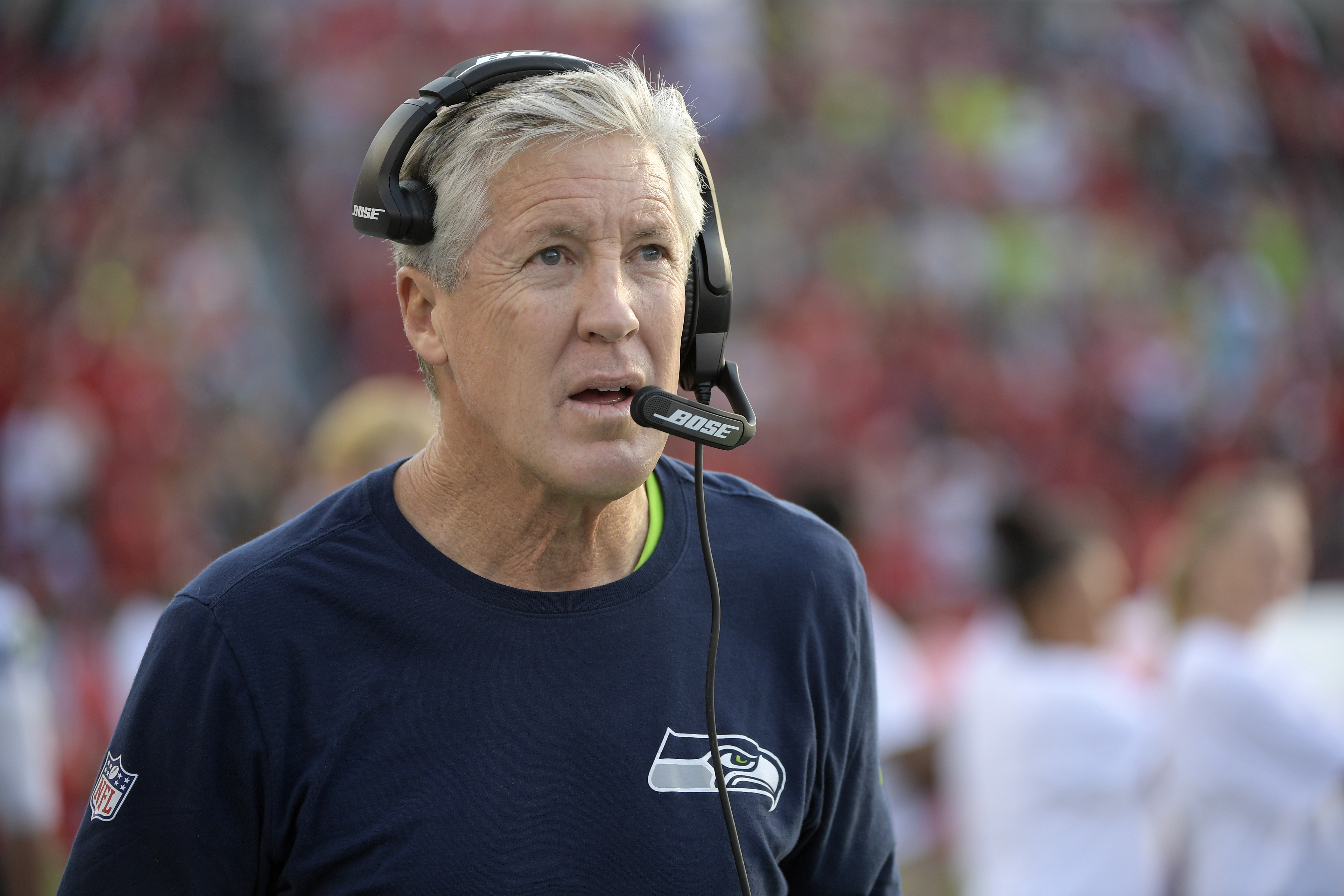 This Nov. 27, 2016 photo shows Seattle Seahawks head coach Pete Carroll walking the sideline prior to the start of an NFL football game against the Tampa Bay Buccaneers in Tampa, Fla. Seattle can wrap up its third NFC West title in the past four seasons w
