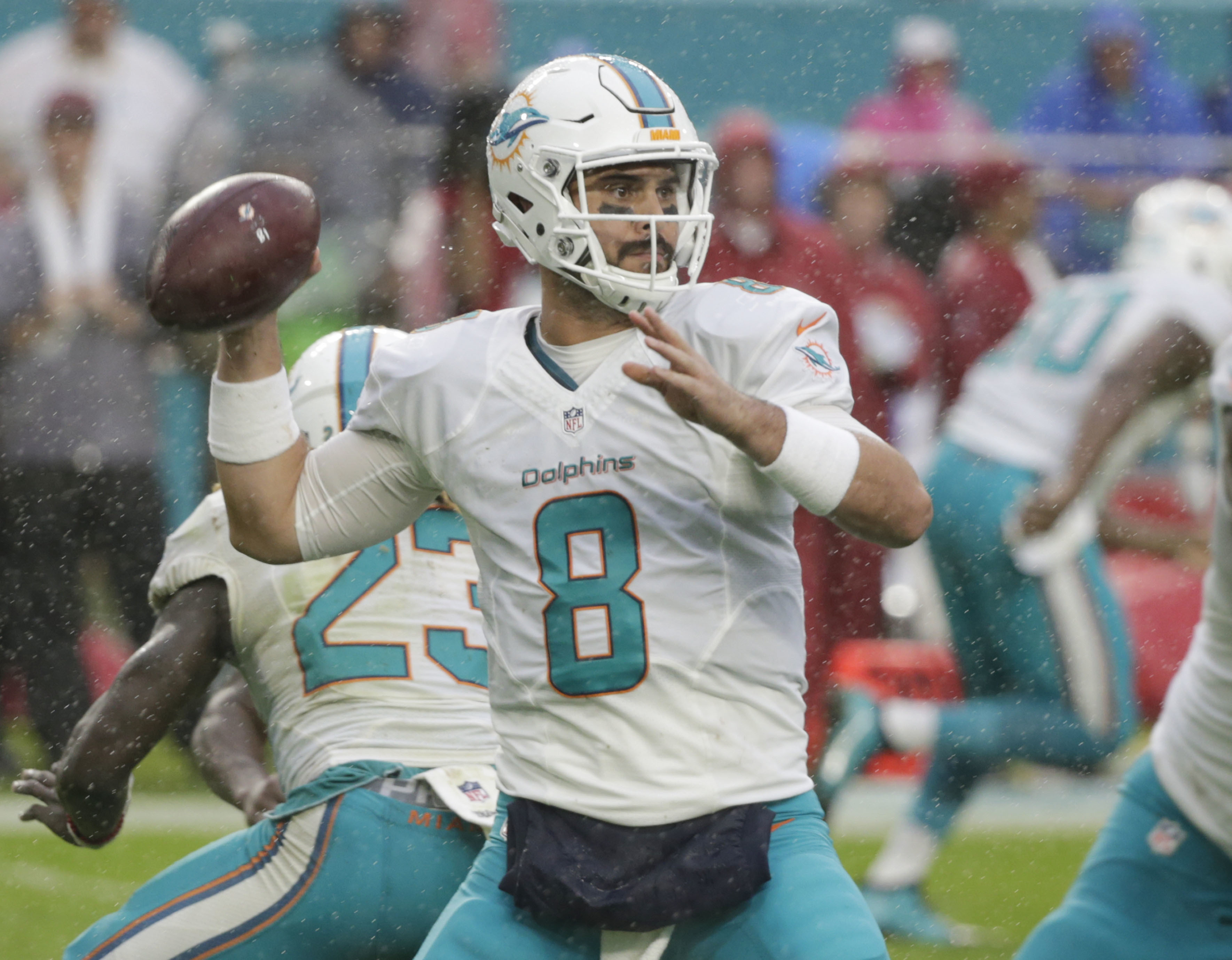 FILE - In this Dec. 11, 2016, file photo Miami Dolphins quarterback Matt Moore (8) looks to pass, during the second half of an NFL football game against the Arizona Cardinals in Miami Gardens, Fla. Moore will start Saturday, Dec. 17, 2016, at the Jets as