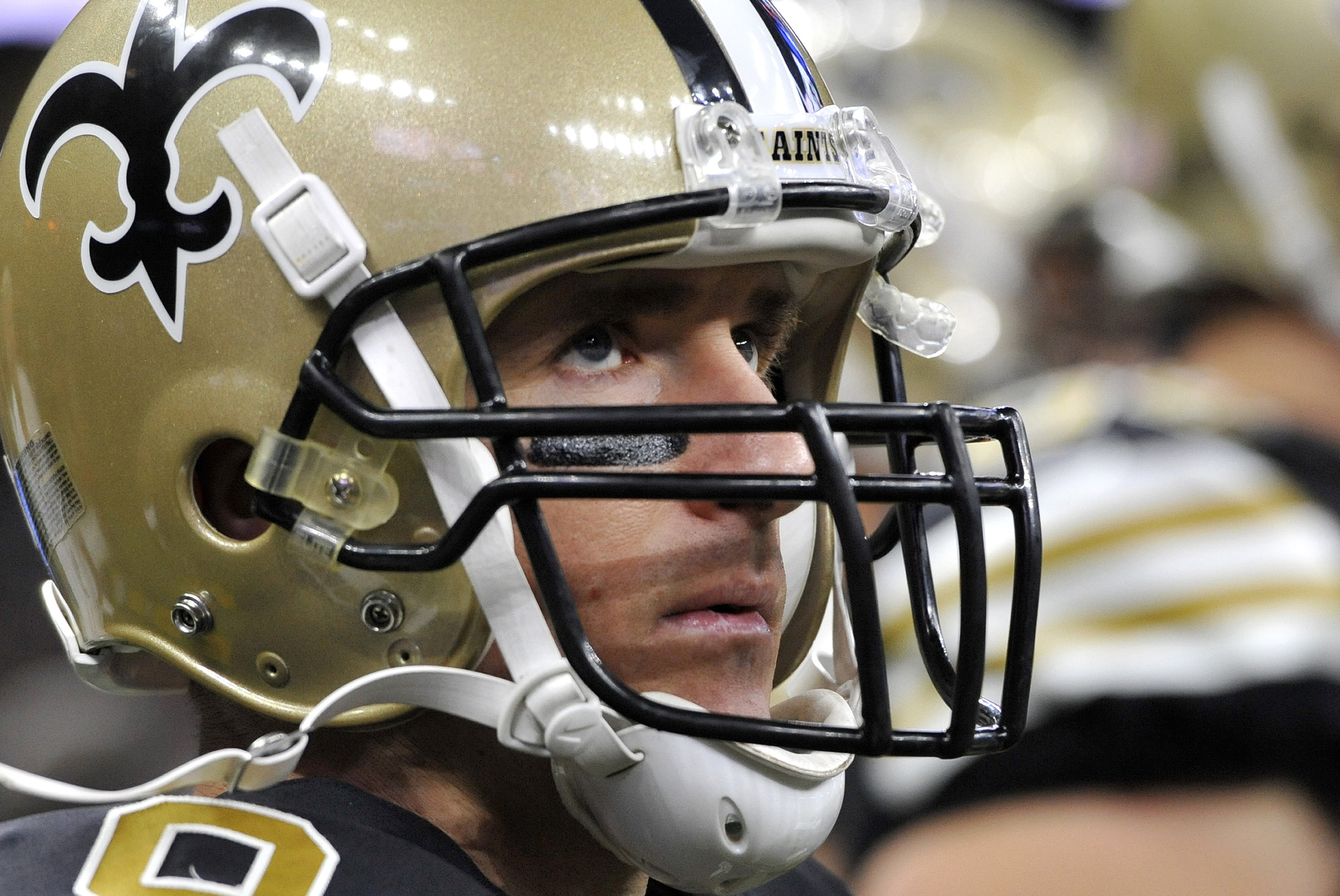 FILE- In this Dec. 4, 2016, file photo, New Orleans Saints quarterback Drew Brees (9) watches from the sideline in the first half of an NFL football game against the Detroit Lions in New Orleans. Brees doesnt dispute the notion that hes had been in a cons