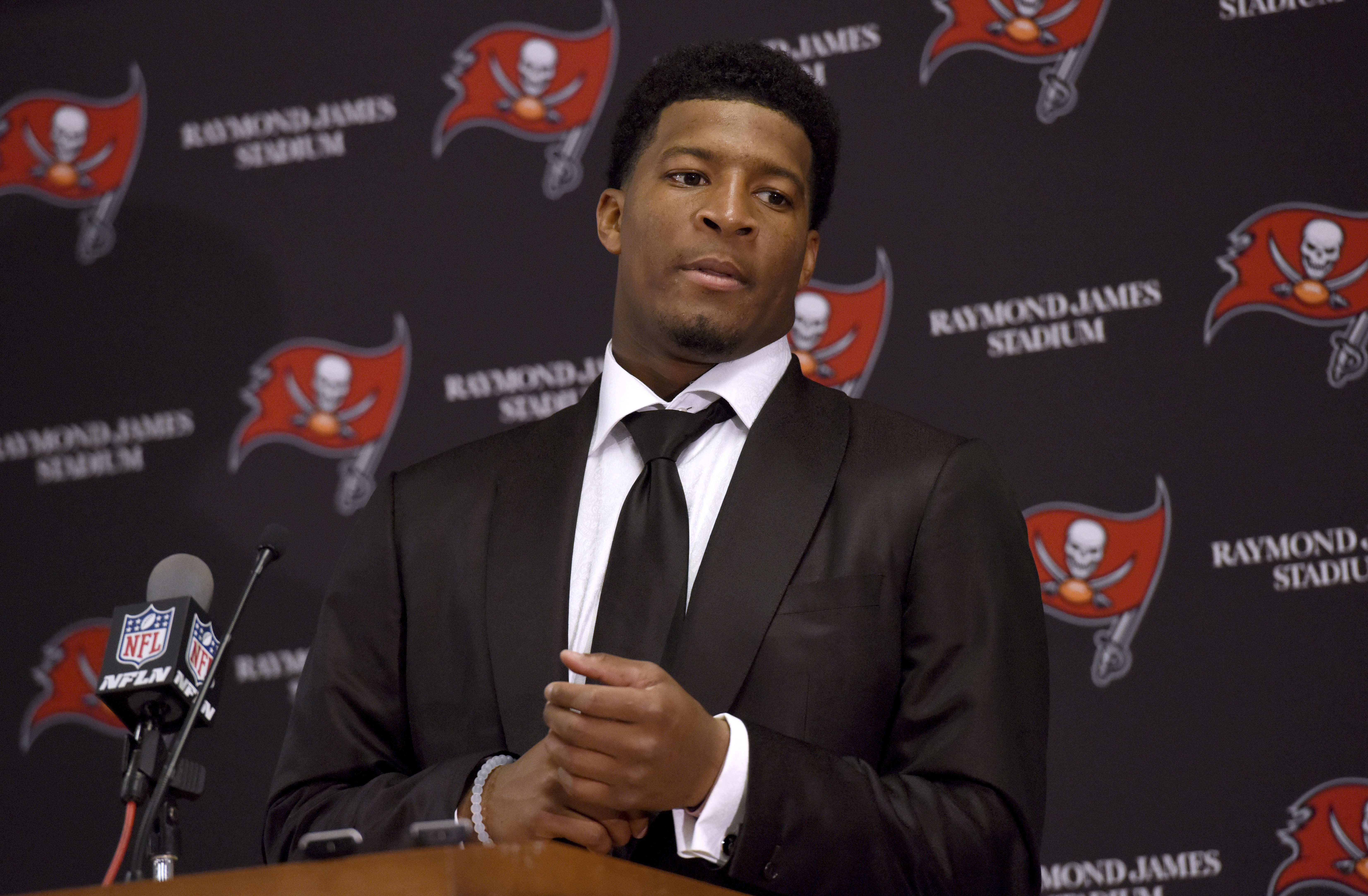 FILE - In this Sunday, Nov. 27, 2016 file photo, Tampa Bay Buccaneers quarterback Jameis Winston (3) speaks to the media following a win over the Seattle Seahawks in an NFL football game, in Tampa, Fla. Winston and the woman who accused him of rape while