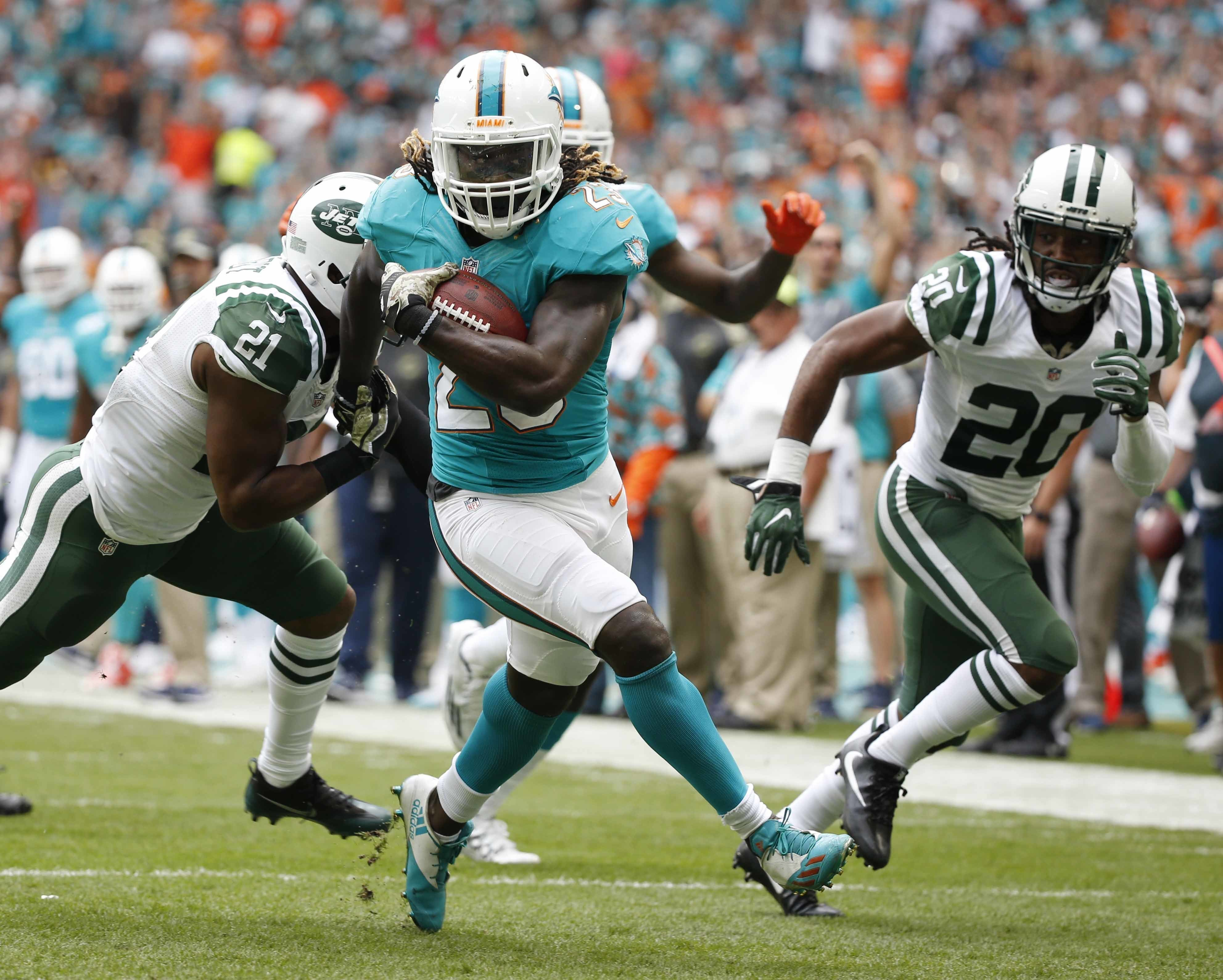 FILE - In this Nov. 6, 2016, file photo, Miami Dolphins running back Jay Ajayi (23) runs for a touchdown during the first half of an NFL football game against the New York Jets, in Miami Gardens, Fla. The surprising success by such low-profile rushers as