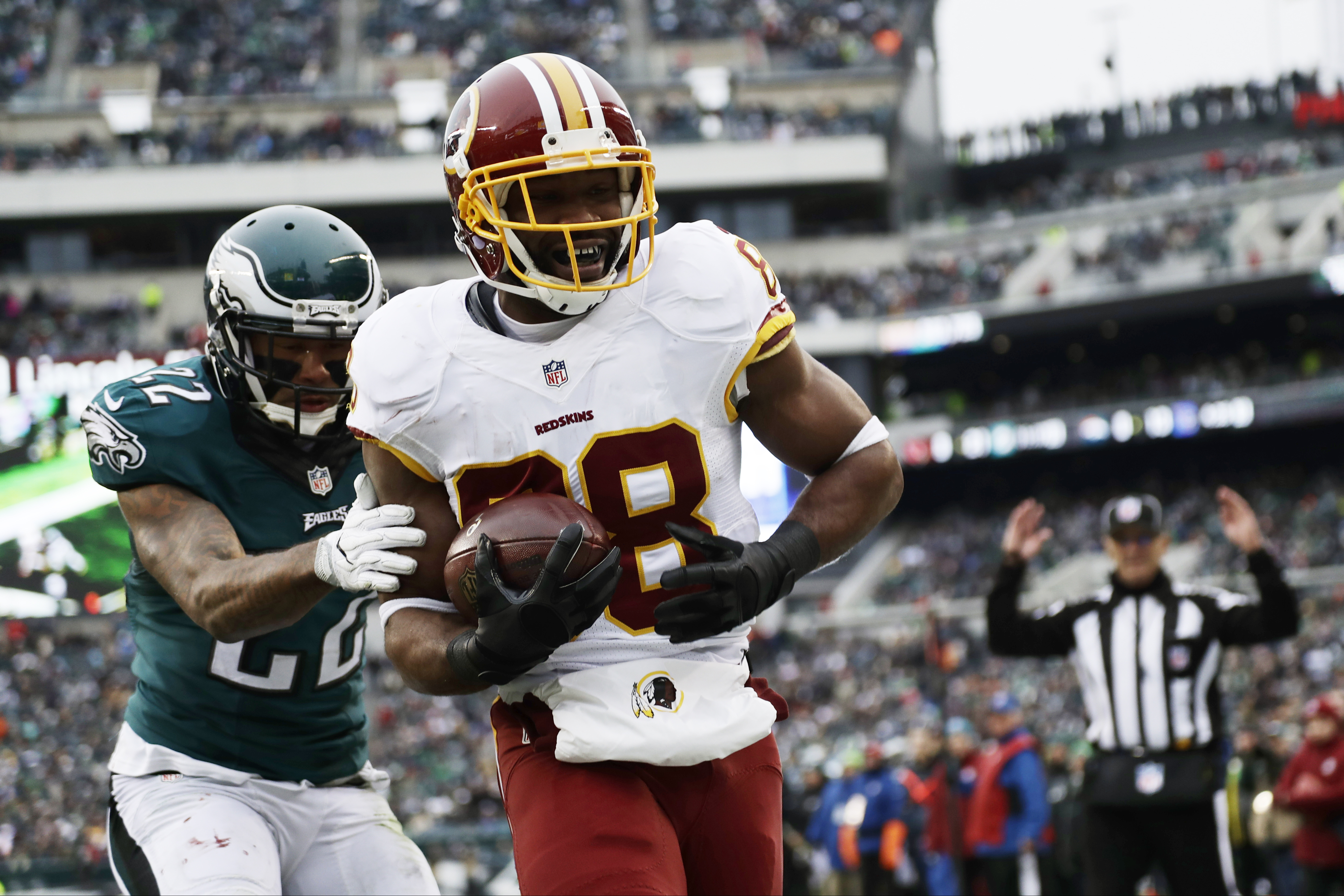 FILE - In this Dec. 11, 2016 file photo, Washington Redskins' Pierre Garcon, right, scores a touchdown past Philadelphia Eagles' Nolan Carroll during the second half of an NFL football game in Philadelphia. The veteran wide receiver Garcon hasnt missed a