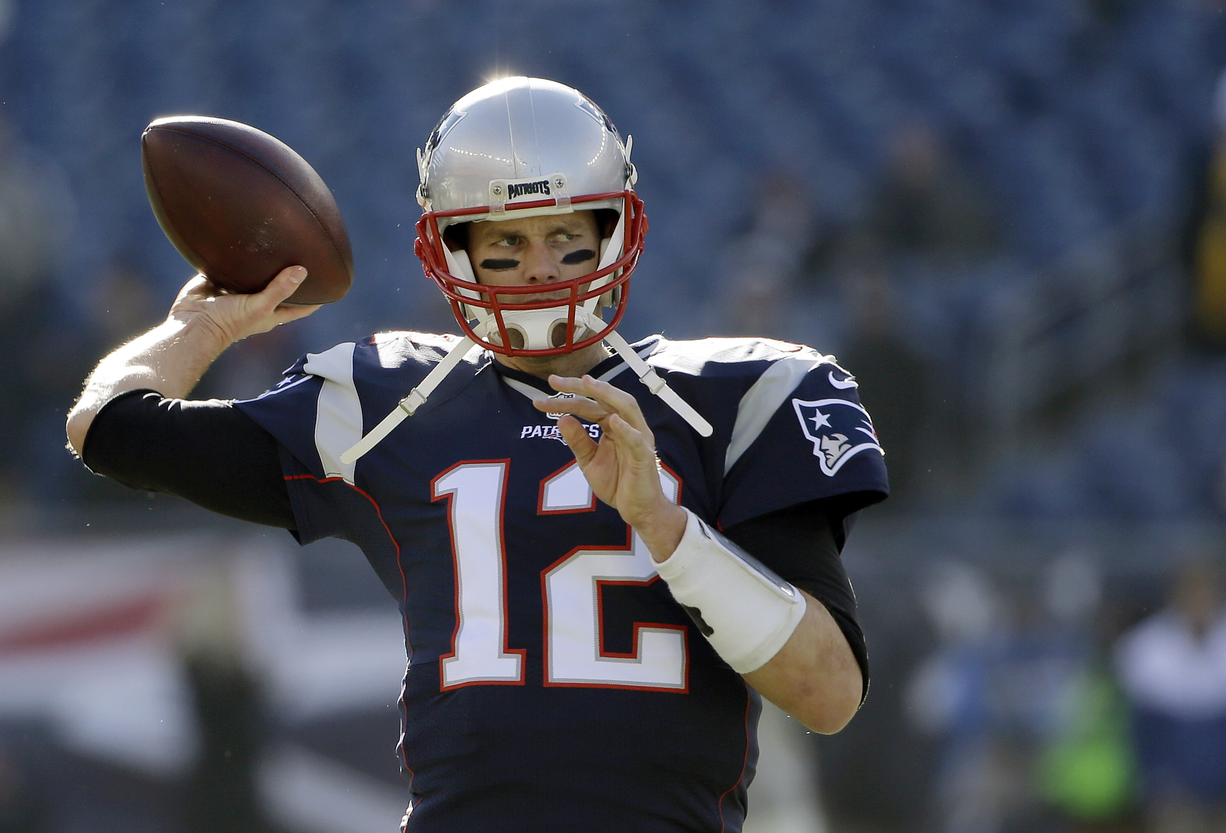 FILE - IN this Sunday, Dec. 4, 2016 file photo, New England Patriots quarterback Tom Brady warms up before an NFL football game against the Los Angeles Rams in Foxborough, Mass. As usual, the Patriots are pushing for the AFC's best record. With a win they
