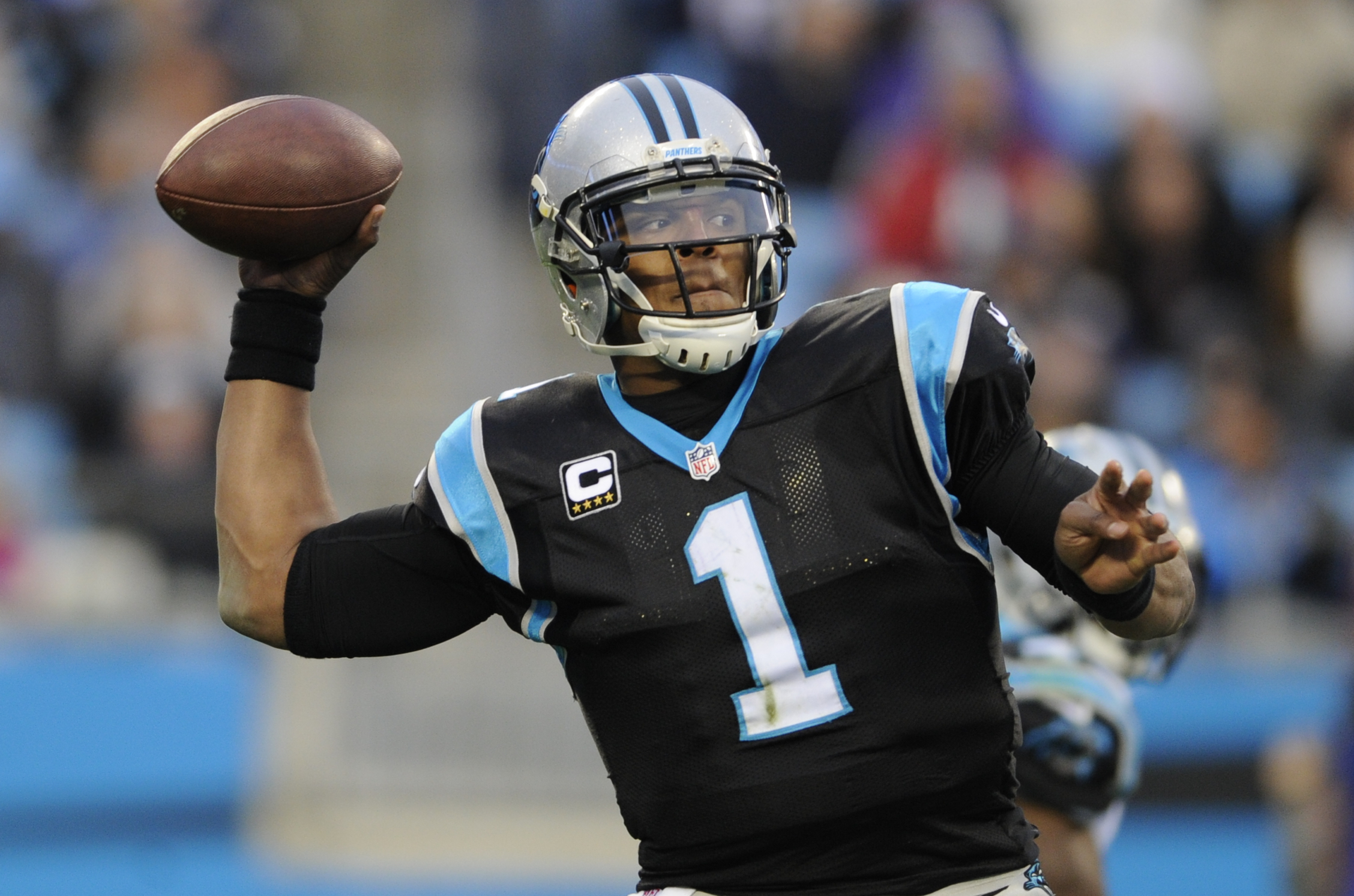 FILE - In a Sunday Dec. 11, 2016 file photo, Carolina Panthers' Cam Newton (1) looks to pass against the San Diego Chargers in the second half of an NFL football game in Charlotte, N.C. Over a year has passed since the Carolina Panthers crushed the Washin