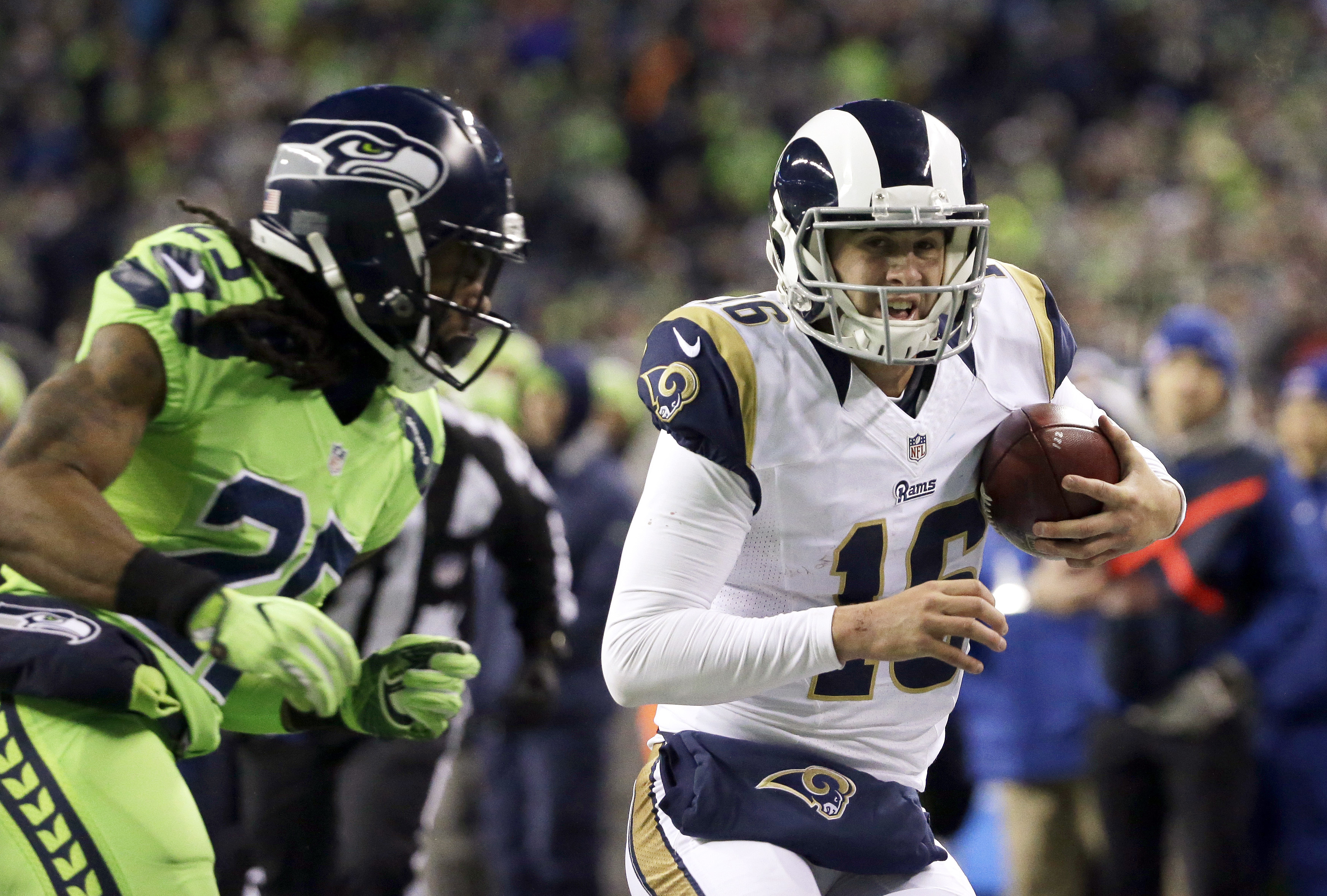 Los Angeles Rams quarterback Jared Goff, right, heads for the sideline just before being hit by Seattle Seahawks cornerback Richard Sherman, left, in the second half of an NFL football game, Thursday, Dec. 15, 2016, in Seattle. Goff left the field with an