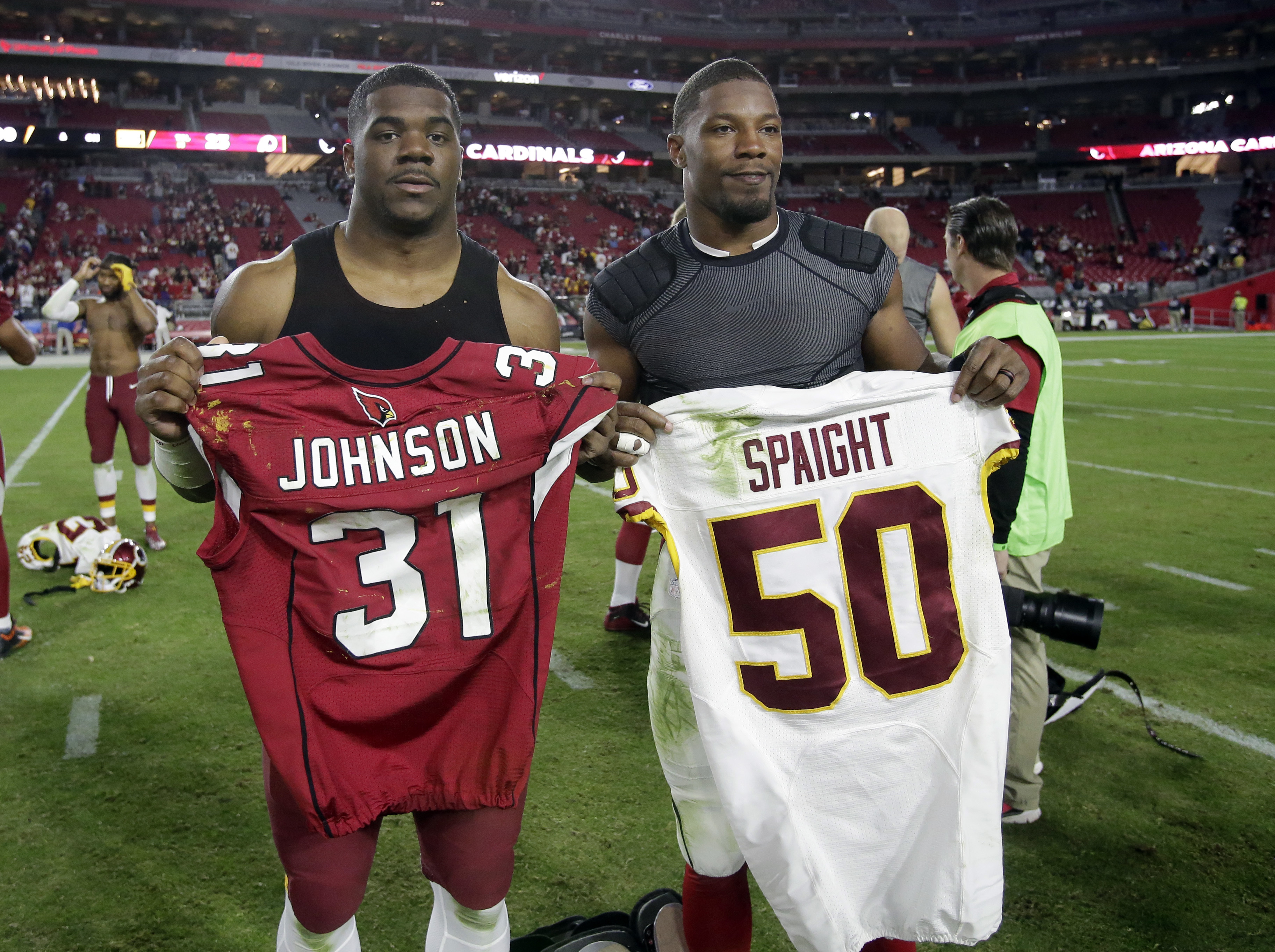 FILE - In this Dec. 4, 2016, file photo, Washington Redskins outside linebacker Martrell Spaight , left, and Arizona Cardinals running back David Johnson swap jerseys after an NFL football game in Glendale, Ariz. Last year Spaight was so sensitive to ligh