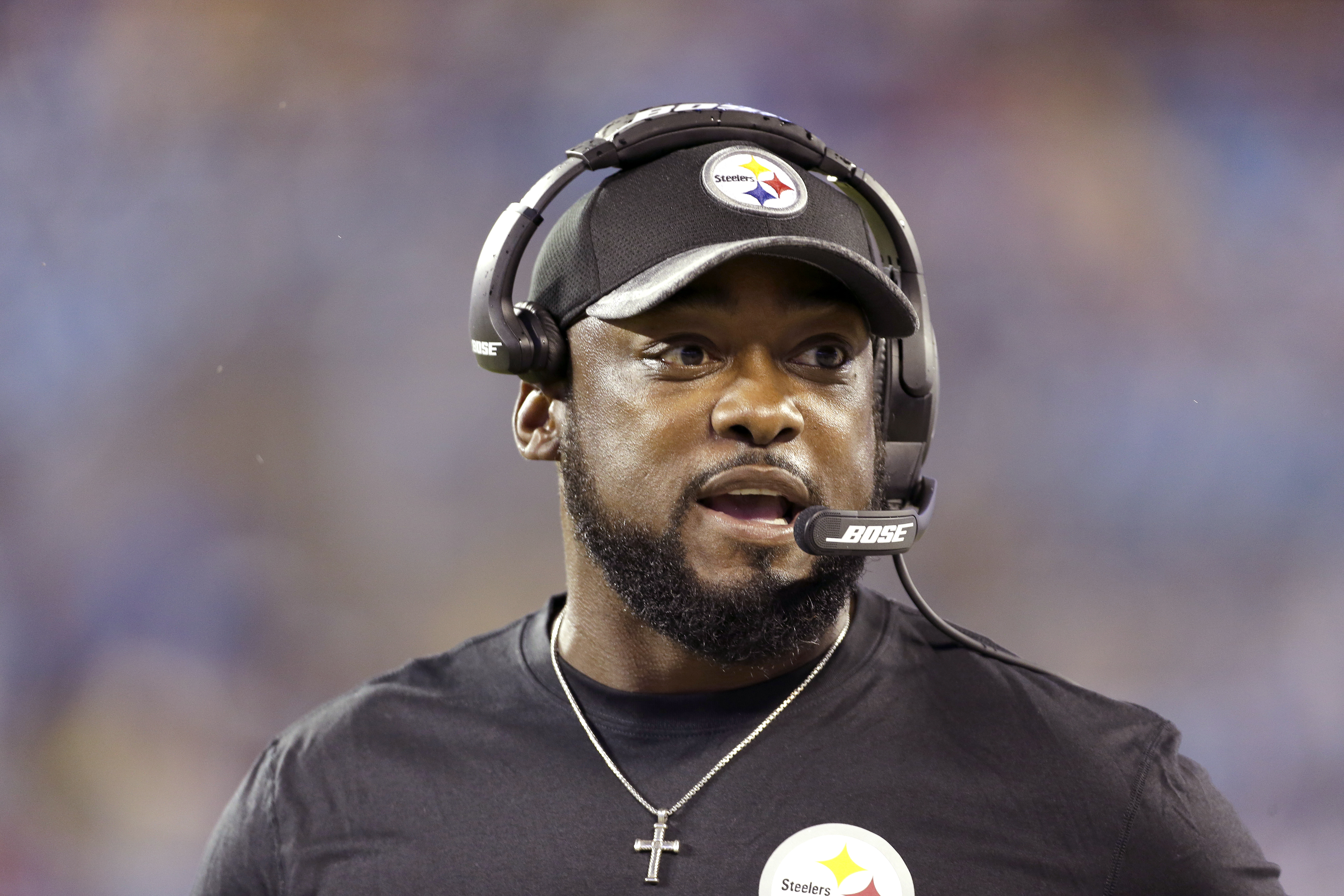 FILE - In this Thursday, Sept. 1, 2016 file photo, Pittsburgh Steelers' head coach Mike Tomlin watches from the sidelines during the first half of an NFL preseason football game against the Carolina Panthers in Charlotte, N.C. Minutes after becoming just