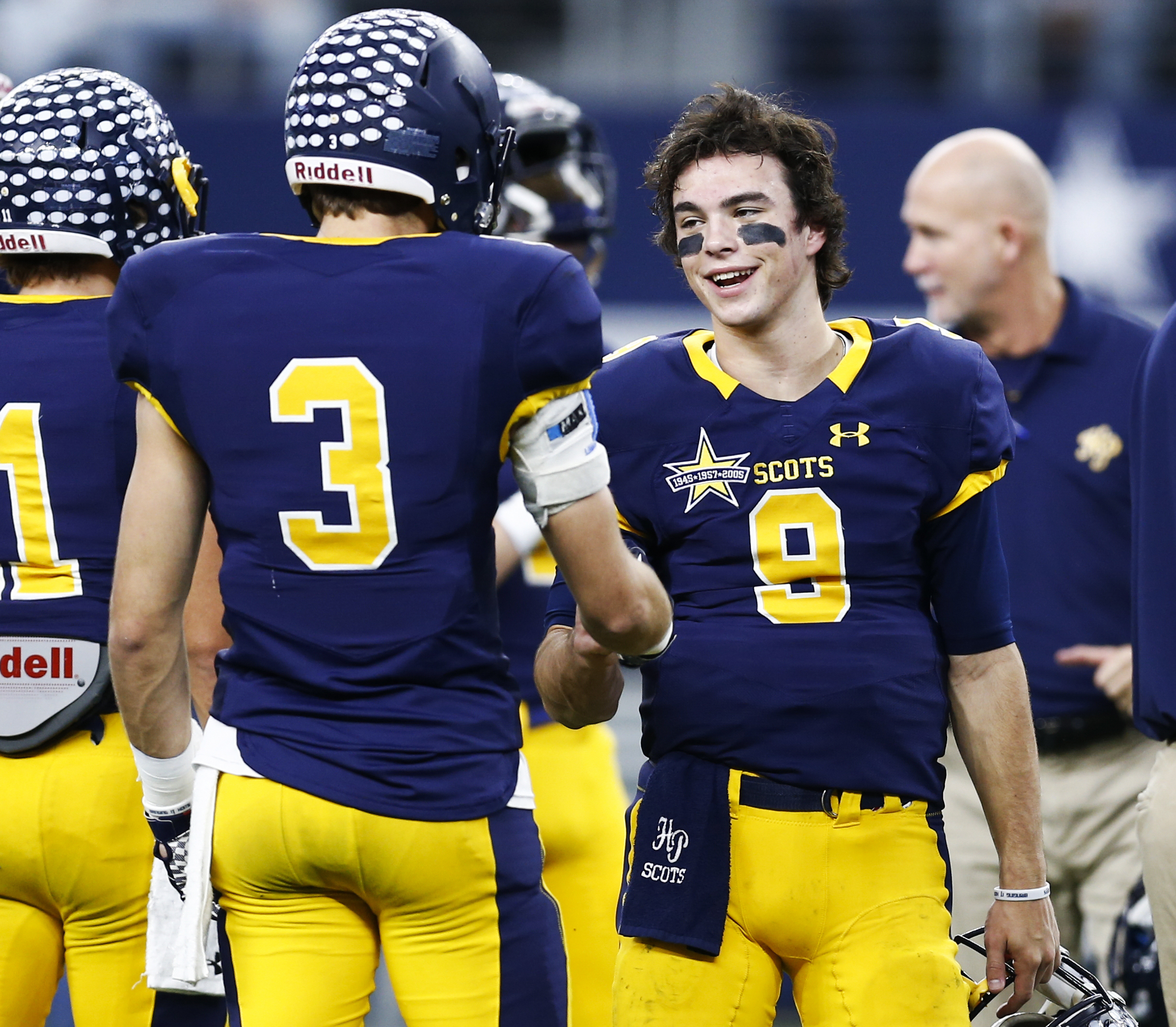 Highland Park quarterback John Stephen Jones (9) greets teammate J.T. Dooley (3) before a UIL Class 5A Division I state championship football game against the Temple, Saturday, Dec. 17, 2016, in Arlington, Texas. John Stephen Jones is the grandson of Dall