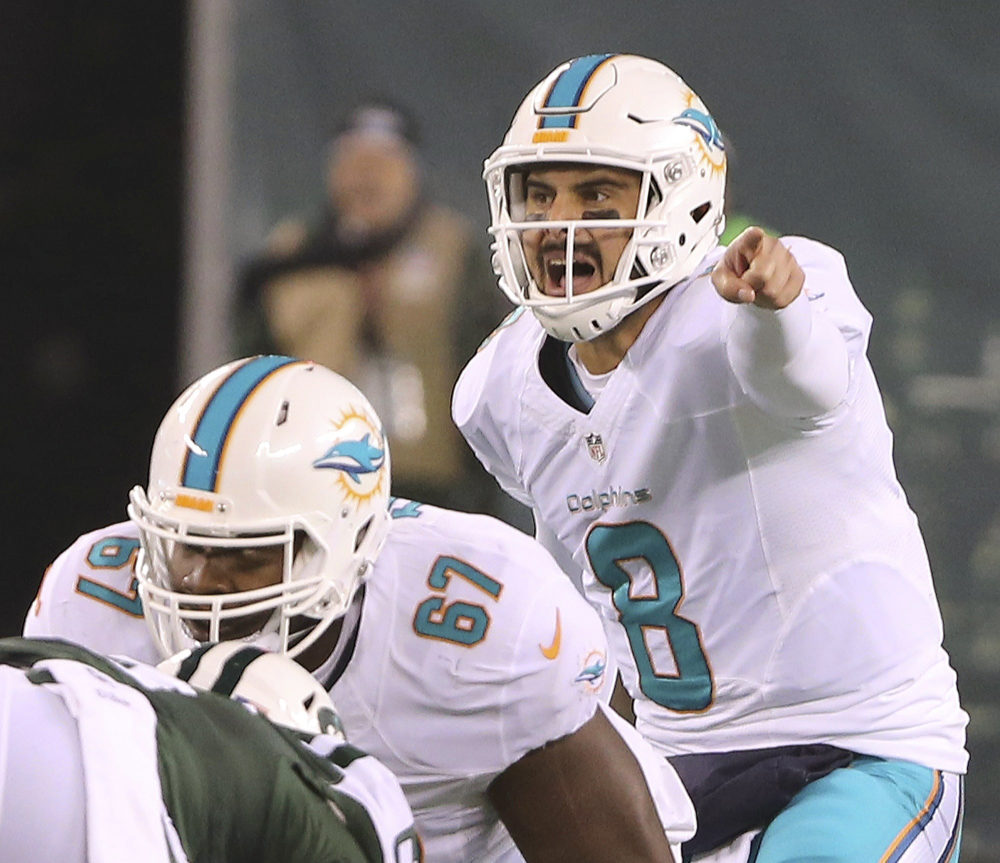Miami Dolphins quarterback Matt Moore (8) shouts as he waits for the snap in the first half of an NFL football game against the New York Jets, Saturday, Dec. 17, 2016, in East Rutherford, N.J. (Charles Trainor  /Miami Herald via AP)