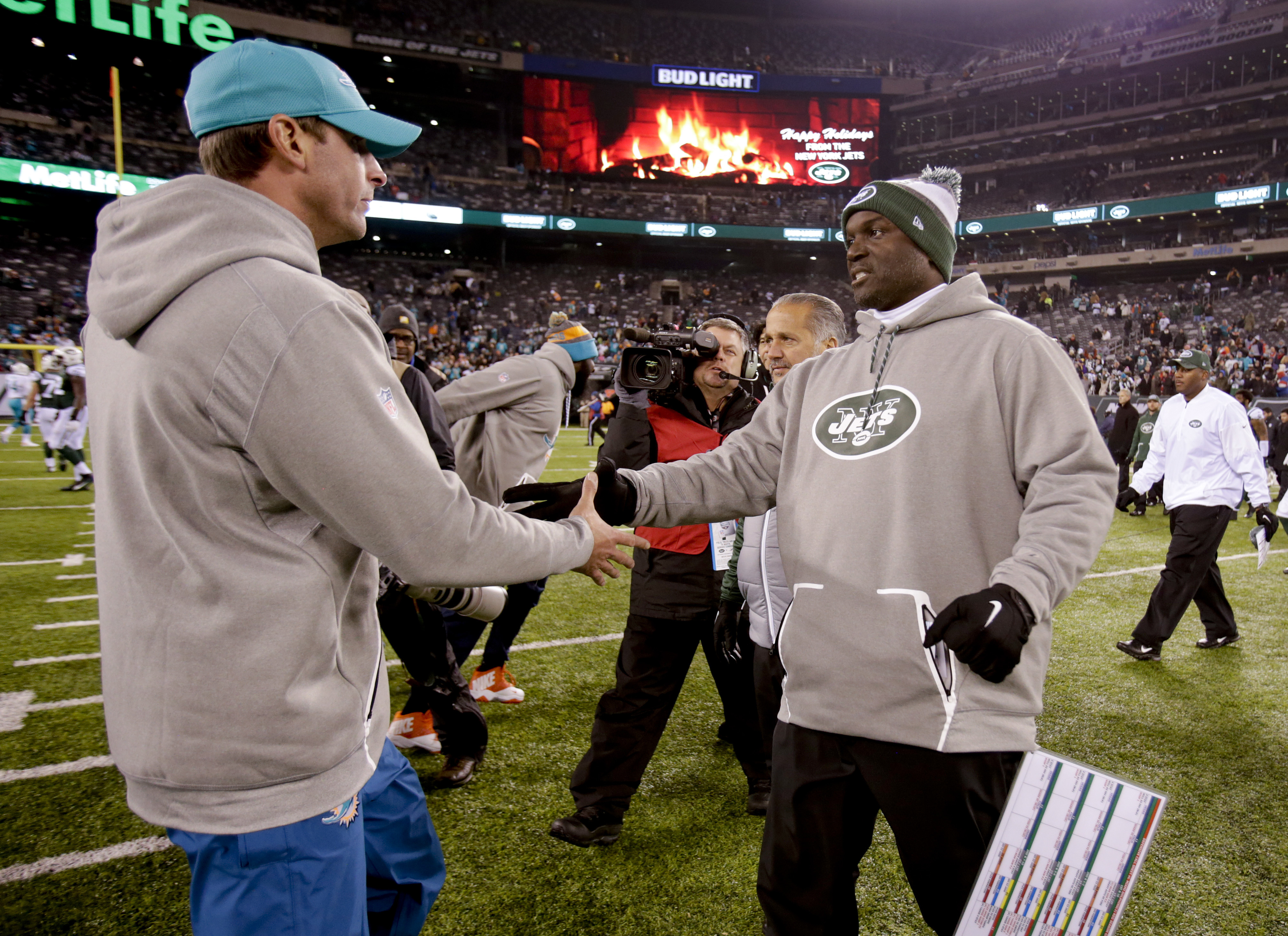 New York Jets head coach Todd Bowles, right, greets Miami Dolphins head coach Adam Gase at mid field after an NFL football game, Saturday, Dec. 17, 2016, in East Rutherford, N.J. The Dolphins won 34-13. (AP Photo/Adam Hunger)