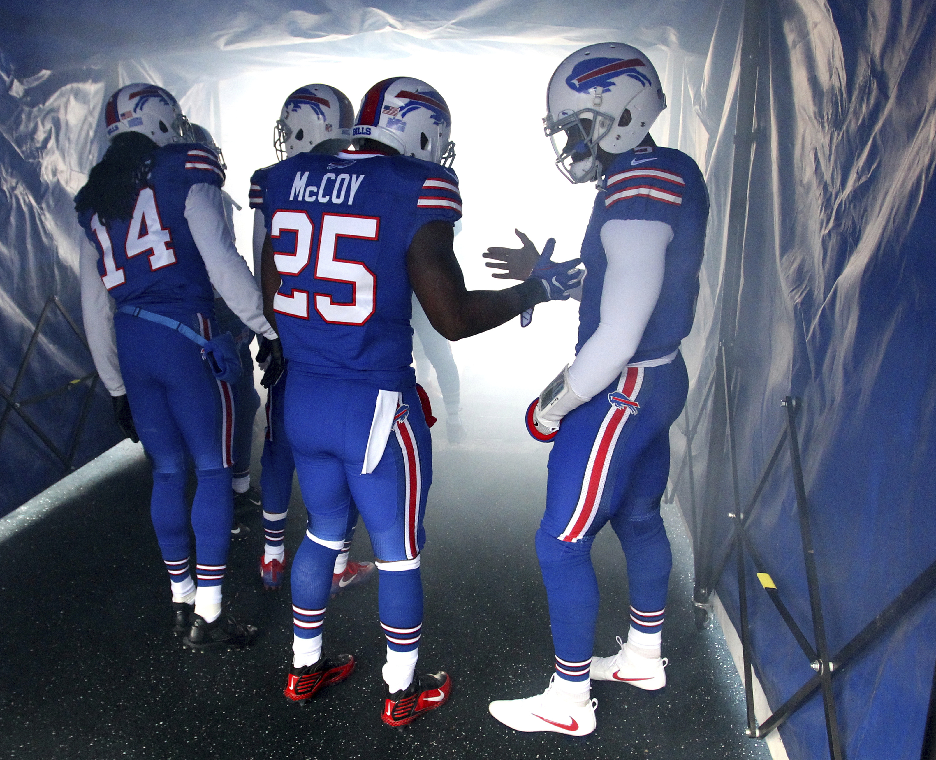 Buffalo Bills quarterback Tyrod Taylor, right, shakes hands with running back LeSean McCoy (25) prior to an NFL football game against the Cleveland Browns, Sunday, Dec. 18, 2016, in Orchard Park, N.Y. (AP Photo/Bill Wippert)