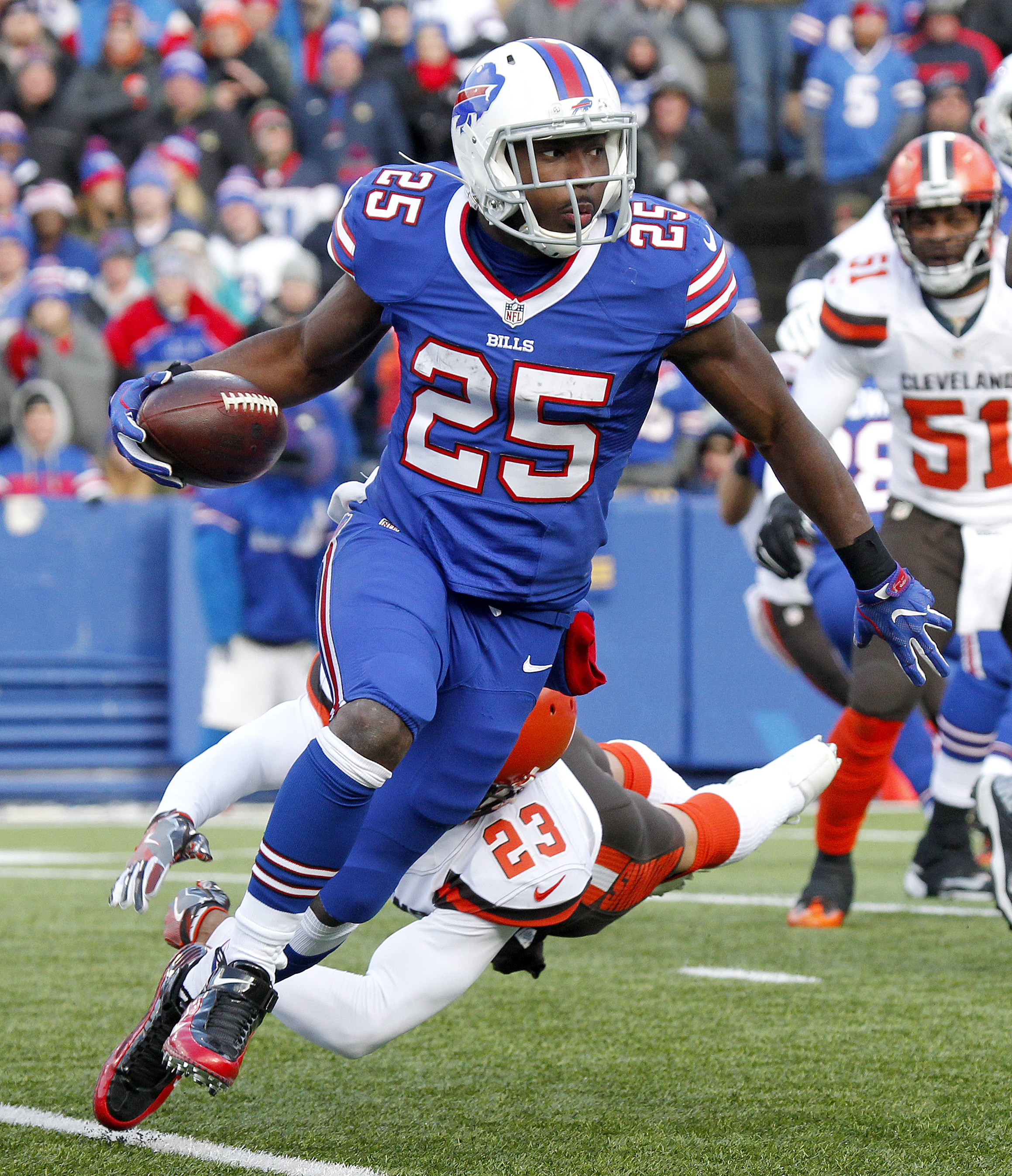 Buffalo Bills running back LeSean McCoy (25) avoids a tackle attempt by Cleveland Browns cornerback Joe Haden (23) during the first half of an NFL football game, Sunday, Dec. 18, 2016, in Orchard Park, N.Y. (AP Photo/Jeffrey T. Barnes)