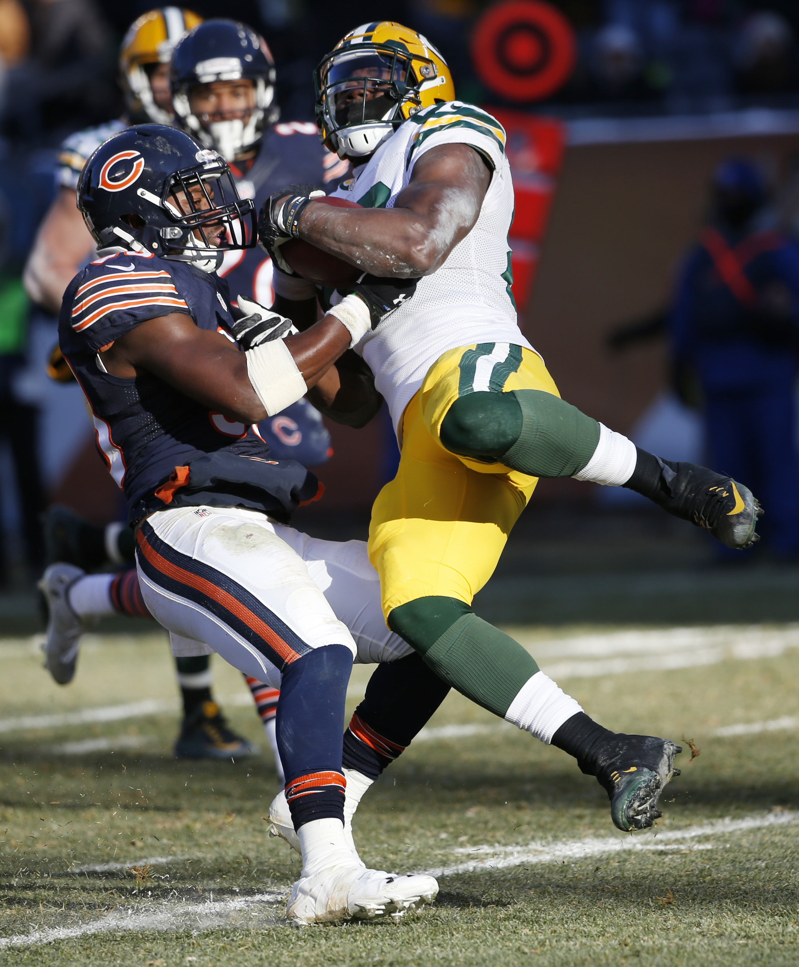 Green Bay Packers receiver Ty Montgomery, right, is tackled by Chicago Bears safety Adrian Amos during the second half of an NFL football game, Sunday, Dec. 18, 2016, in Chicago. (AP Photo/Nam Y. Huh)