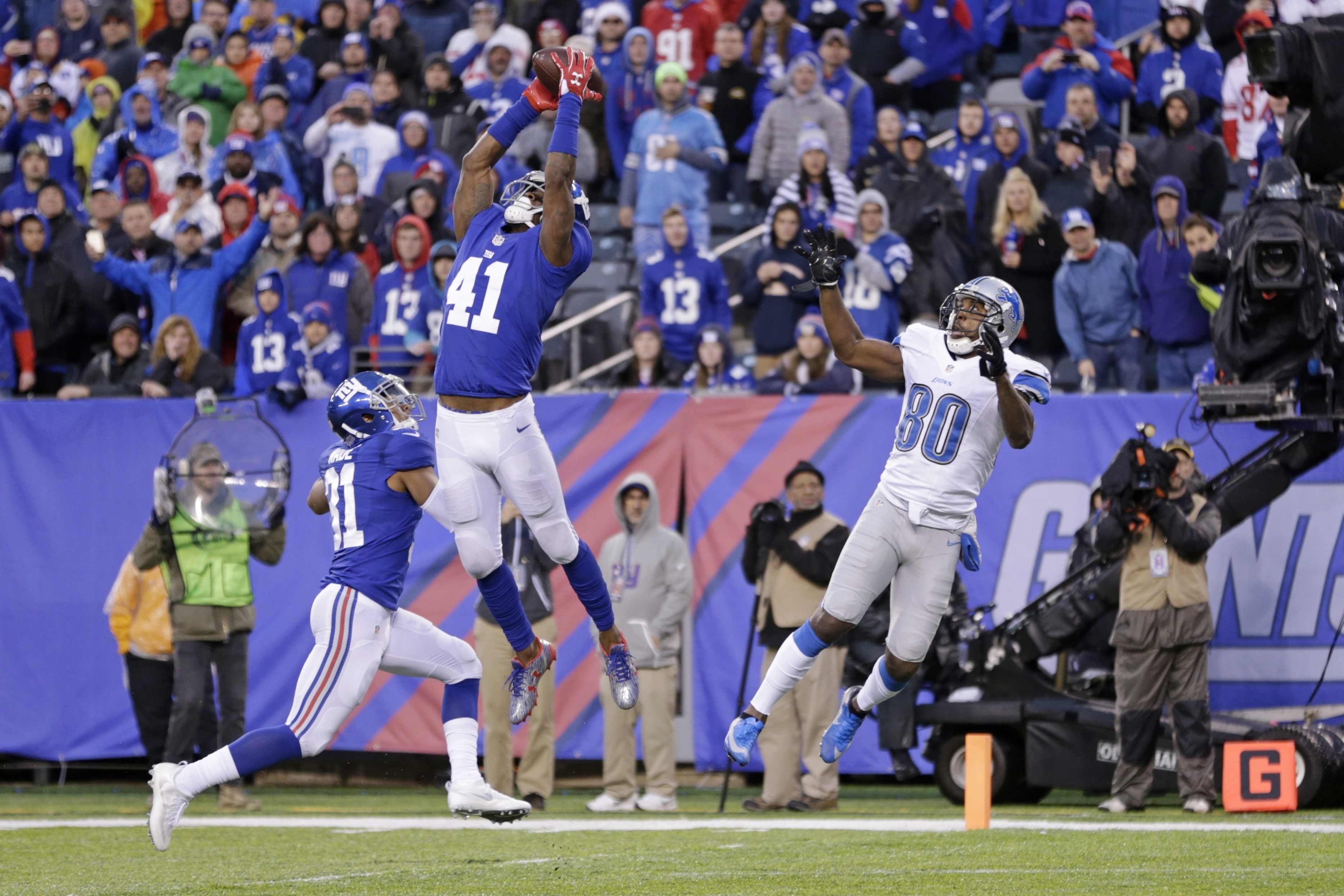 New York Giants cornerback Dominique Rodgers-Cromartie (41) intercepts a pass to Detroit Lions' Anquan Boldin (80) during the second half of an NFL football game Sunday, Dec. 18, 2016, in East Rutherford, N.J. The Giants won 17-6. (AP Photo/Seth Wenig)