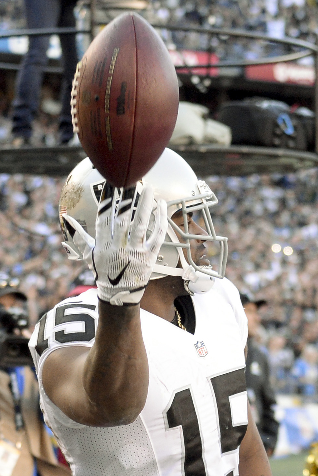 Oakland Raiders wide receiver Michael Crabtree reacts after scoring a touchdown during the first half of an NFL football game against the San Diego Chargers Sunday, Dec. 18, 2016, in San Diego. (AP Photo/Denis Poroy)