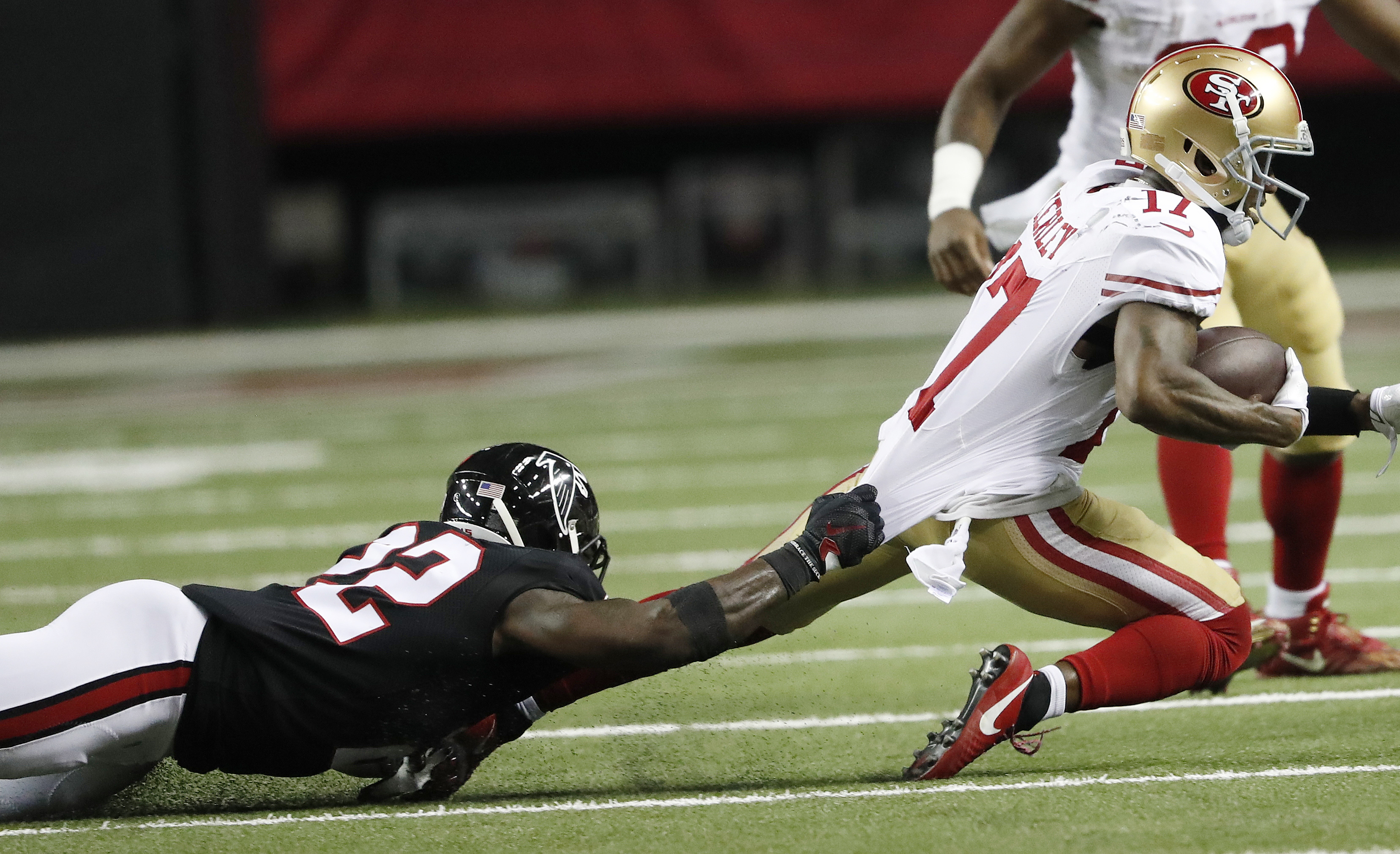 Atlanta Falcons strong safety Keanu Neal (22) tackles San Francisco 49ers wide receiver Jeremy Kerley (17) during the second half of an NFL football game, Sunday, Dec. 18, 2016, in Atlanta. (AP Photo/John Bazemore)