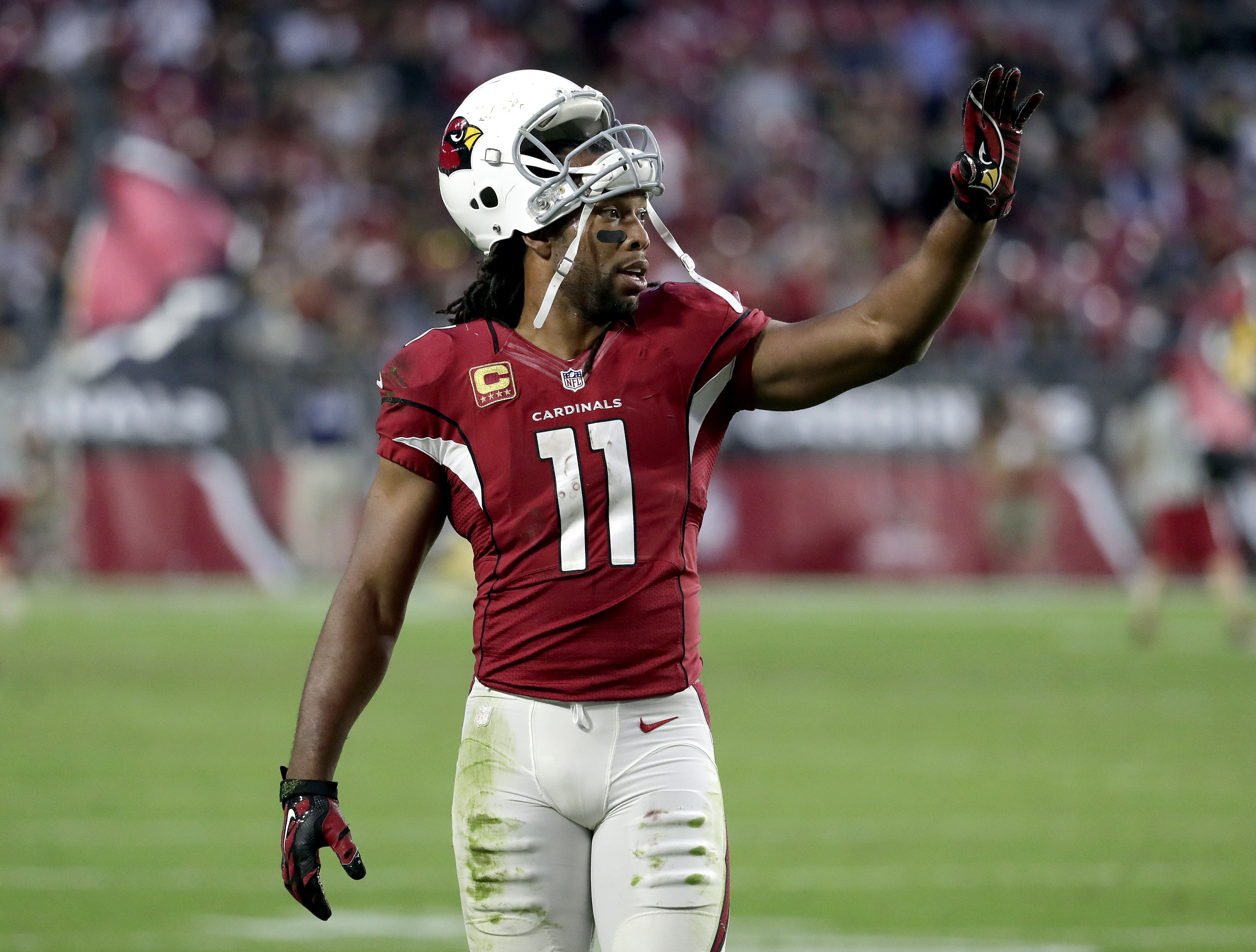 Arizona Cardinals wide receiver Larry Fitzgerald (11) waves during the second half of an NFL football game against the New Orleans Saints , Sunday, Dec. 18, 2016, in Glendale, Ariz. (AP Photo/Rick Scuteri)